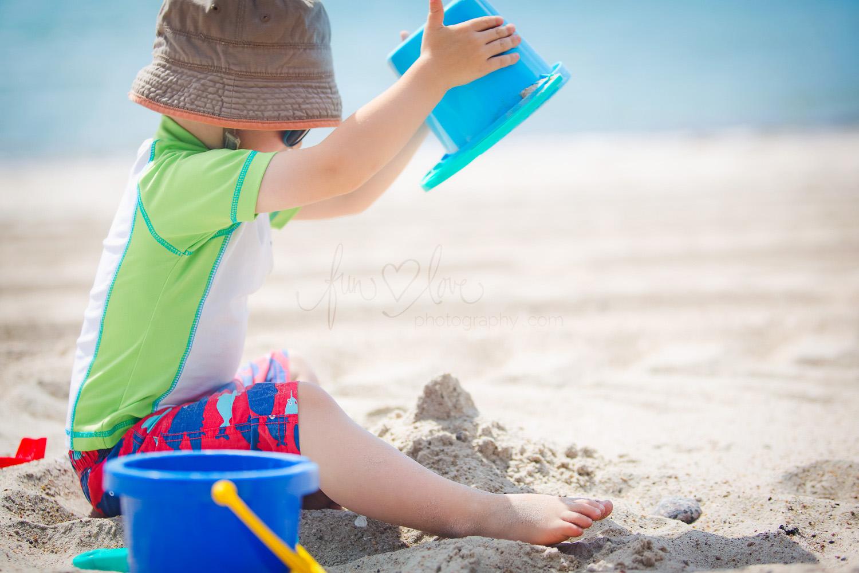 boy-on-beach-with-sand-toys-toronto-family-photography
