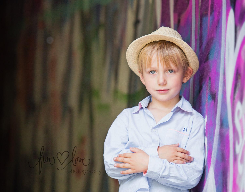 boy-in-hat-by-grafitti-wall-toronto-child-photography