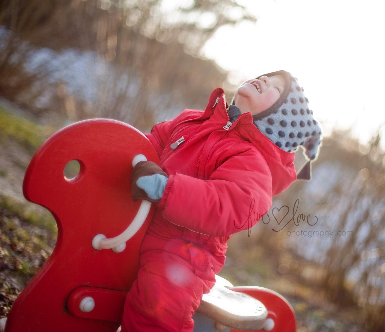 boy-in-snow-suit-in-playground