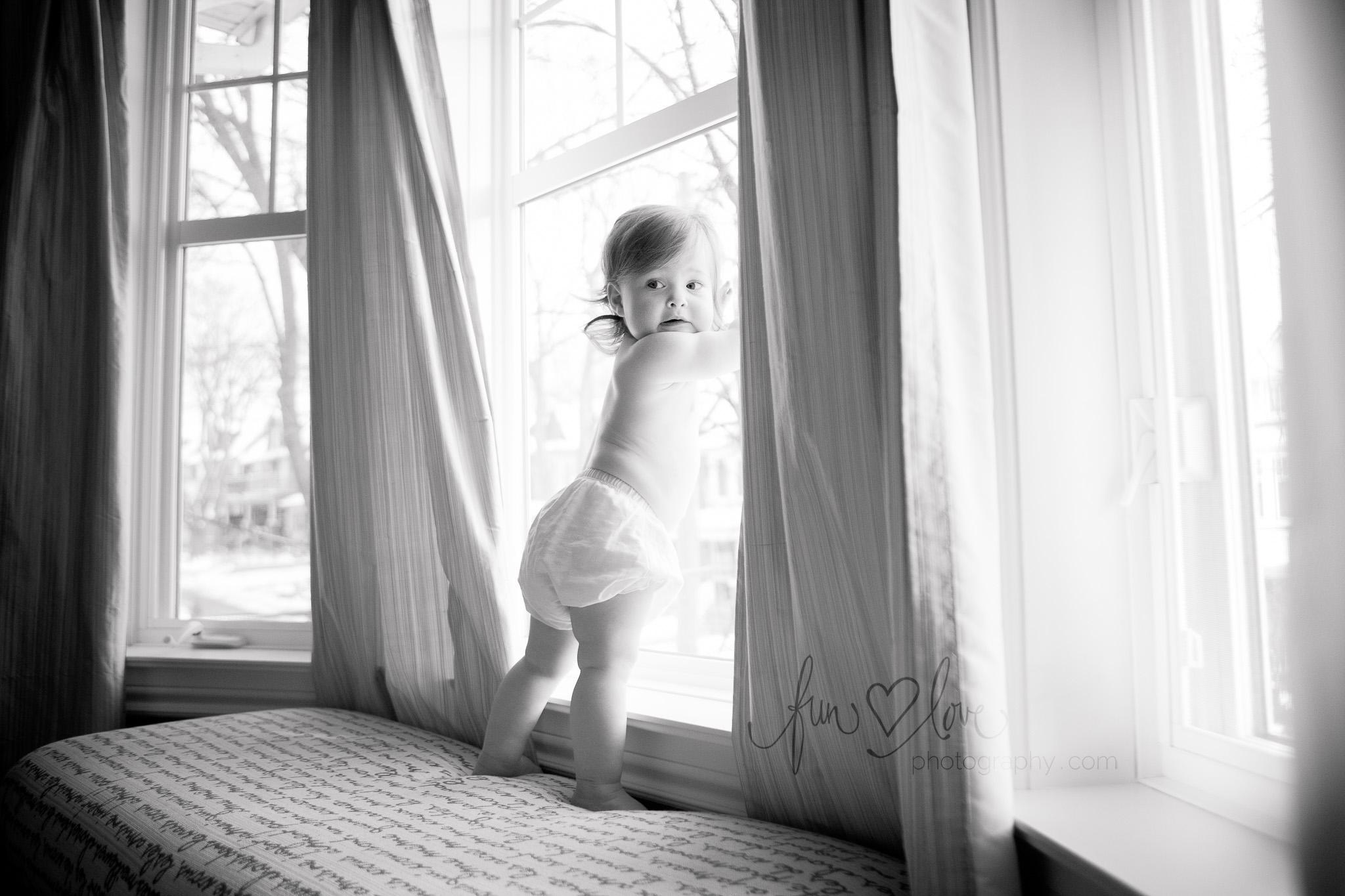 cute baby by window lots of light