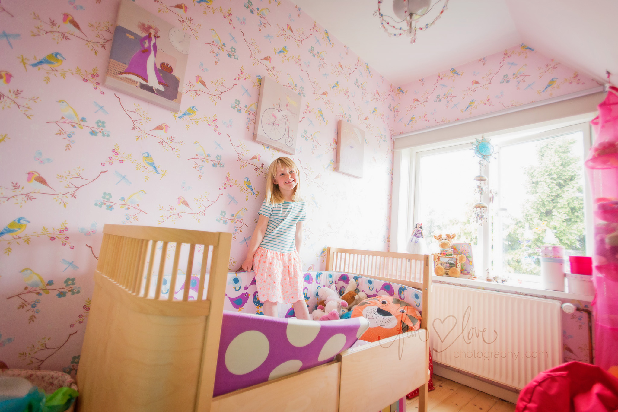 girl in pretty pink bedroom
