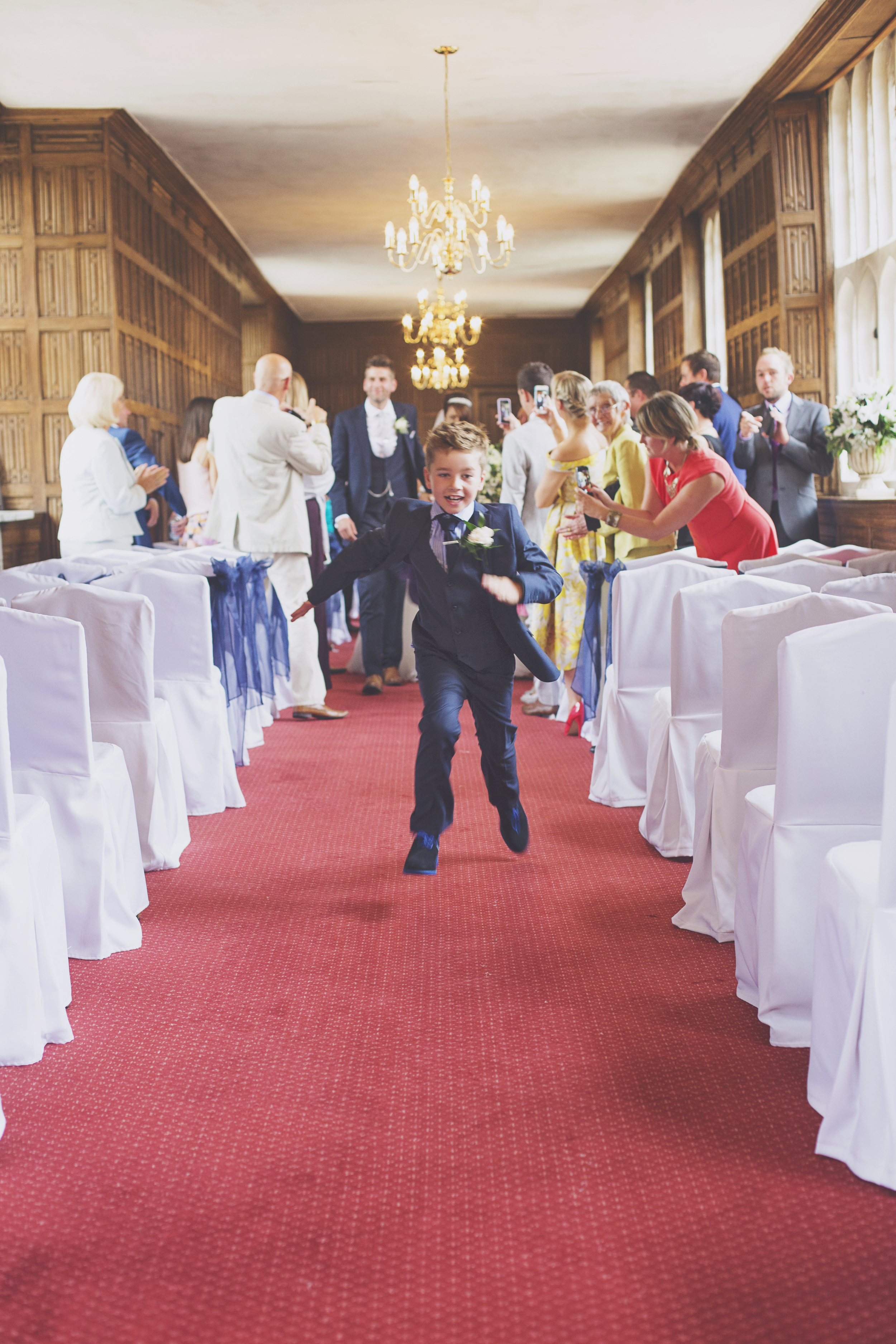 Three Flowers Photography Gosfield Hall Essex wedding Page Boy Running down the isle