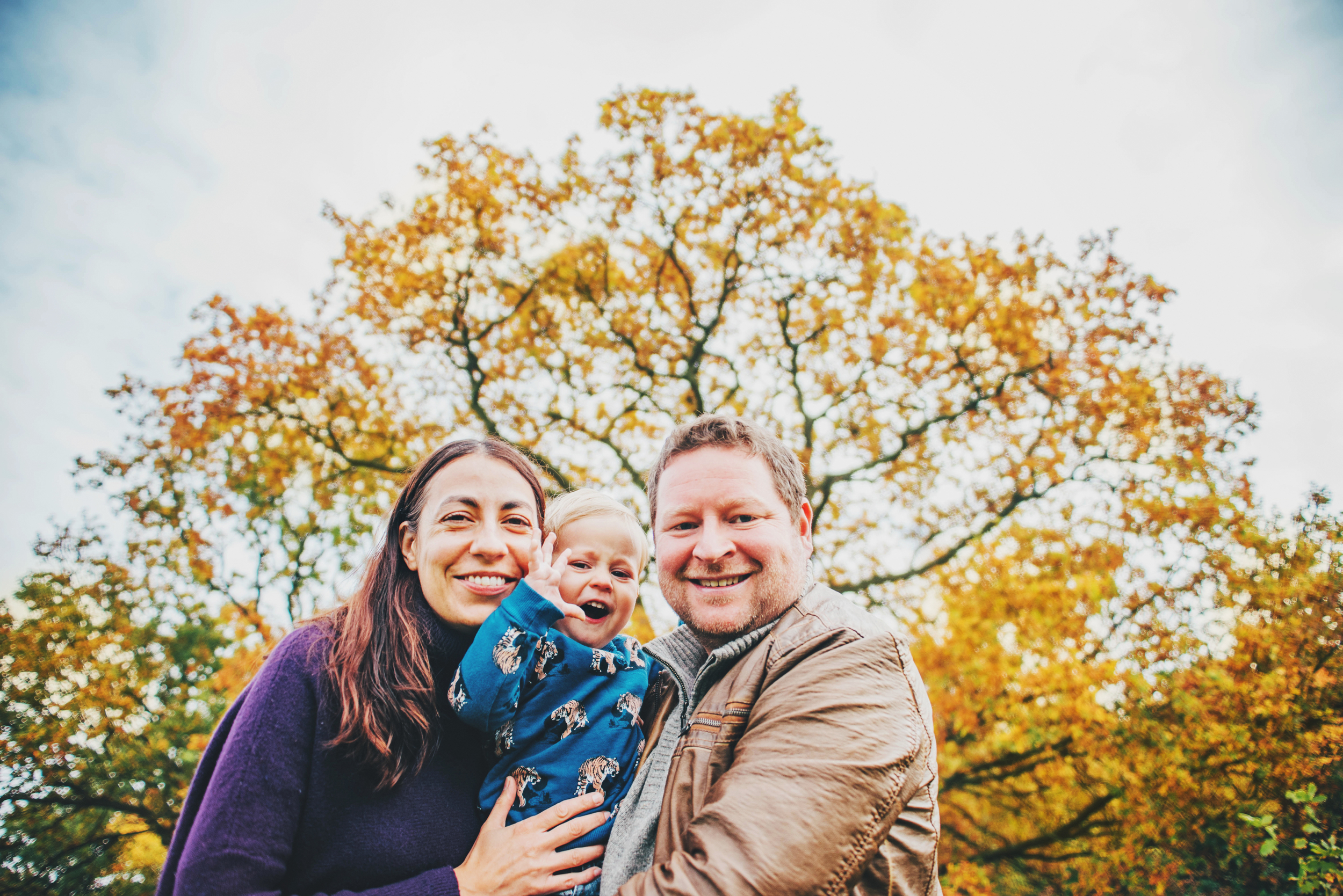 Parents with baby boy in park Essex Documentary and Lifestyle Portrait Photographer