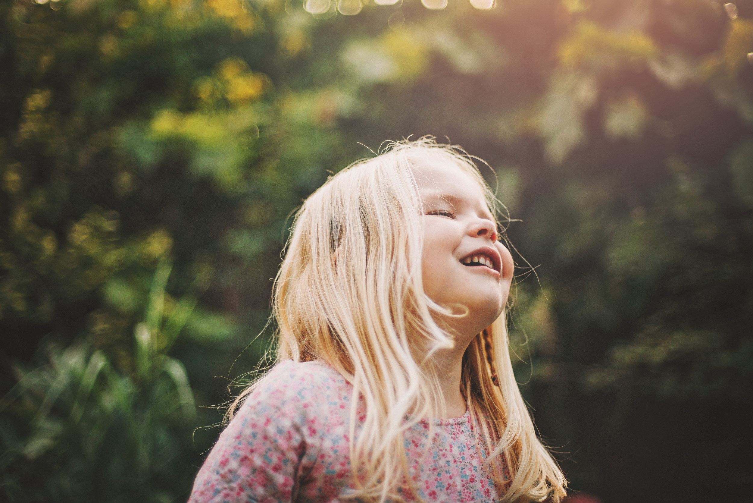 Little girl enjoys sun in the garden Essex Documentary and Lifestyle Portrait Photographer