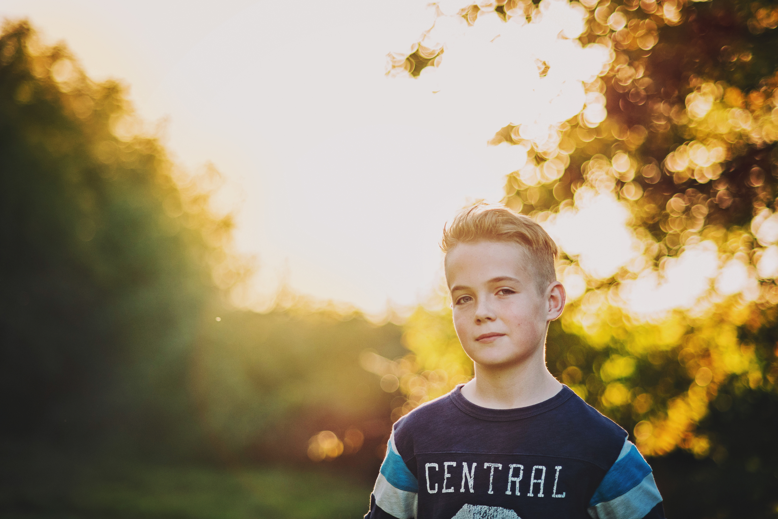 Boy in garden at sunset Essex Documentary and Lifestyle Portrait Photographer