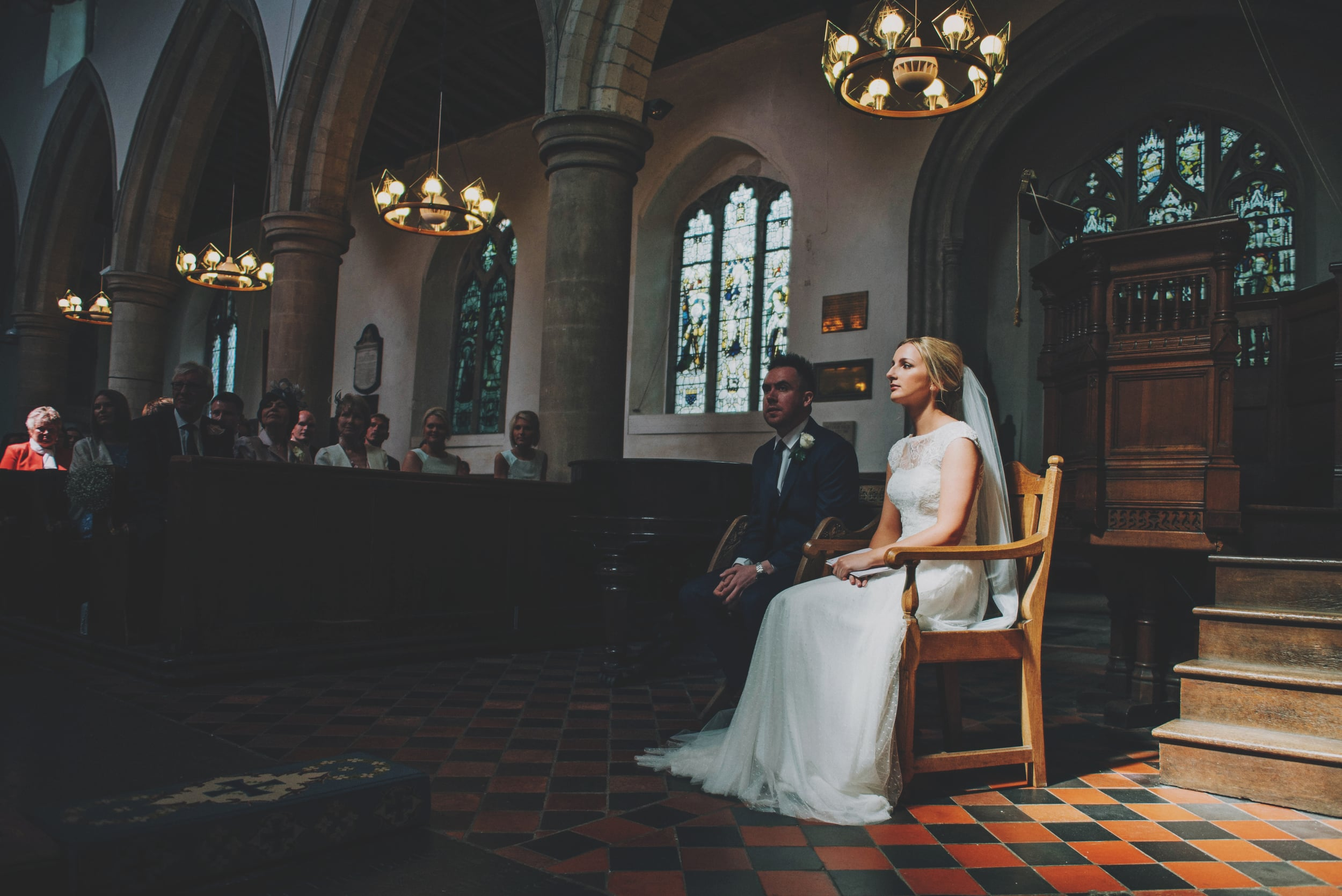 Bride and Groom in church for Rustic Blake Hall Barn Wedding Essex UK Documentary Wedding Photographer