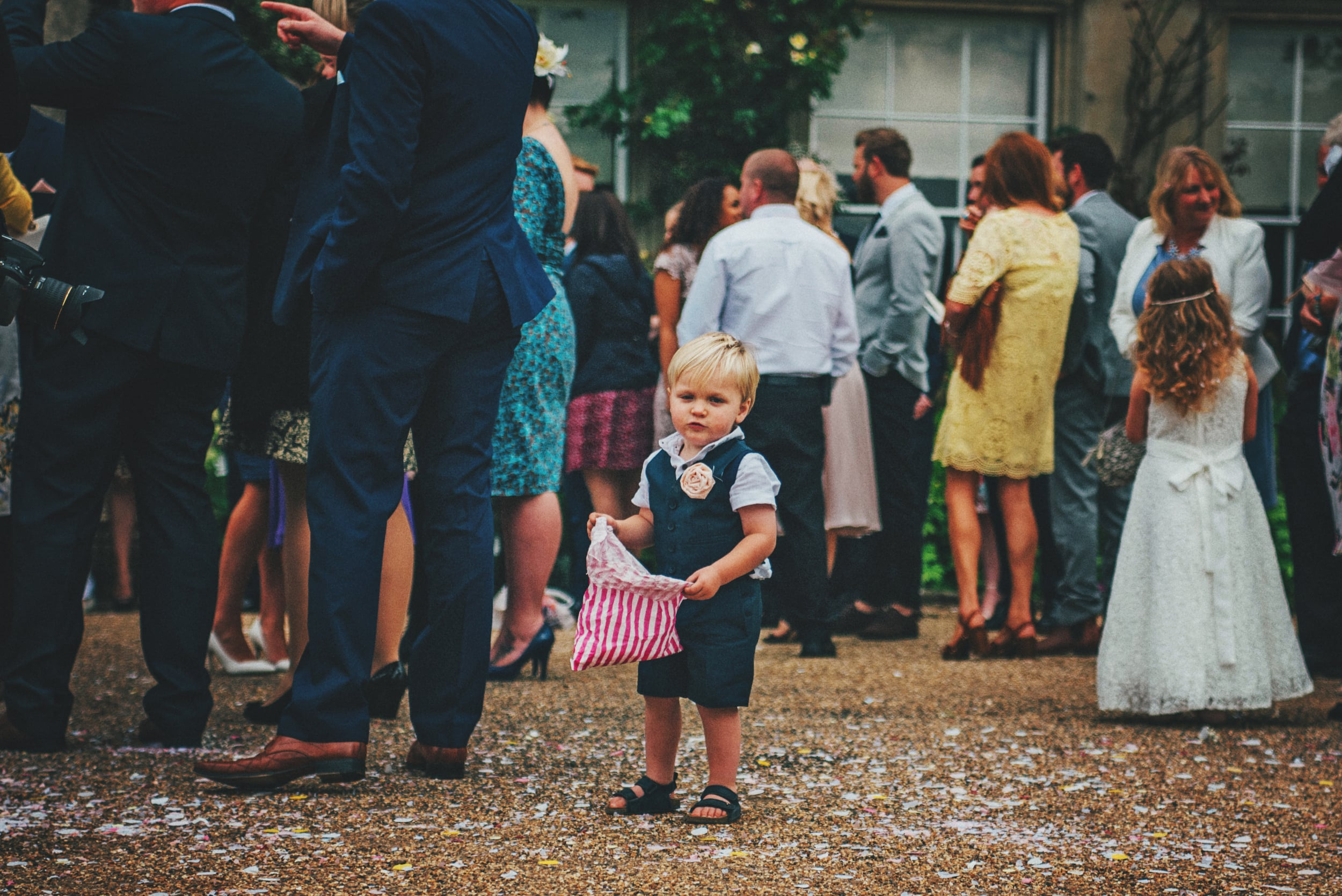 Young boy with confetti bag Rustic Essex UK Documentary Wedding Photographer