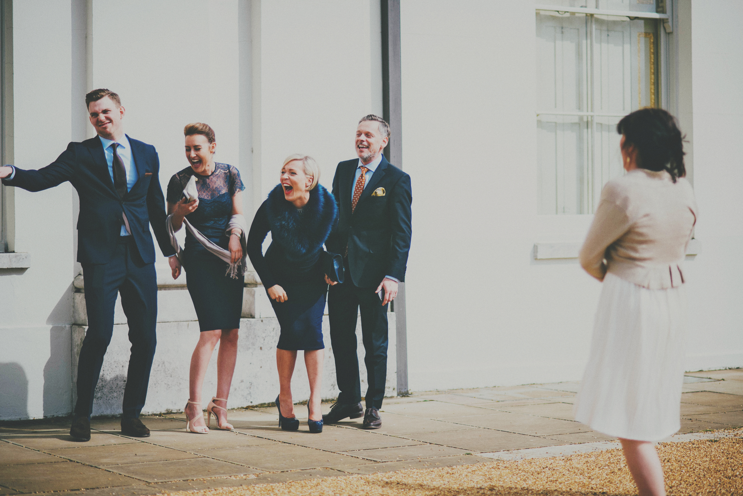 Laughing guests Hylands House UK Documentary Essex Wedding Photographer