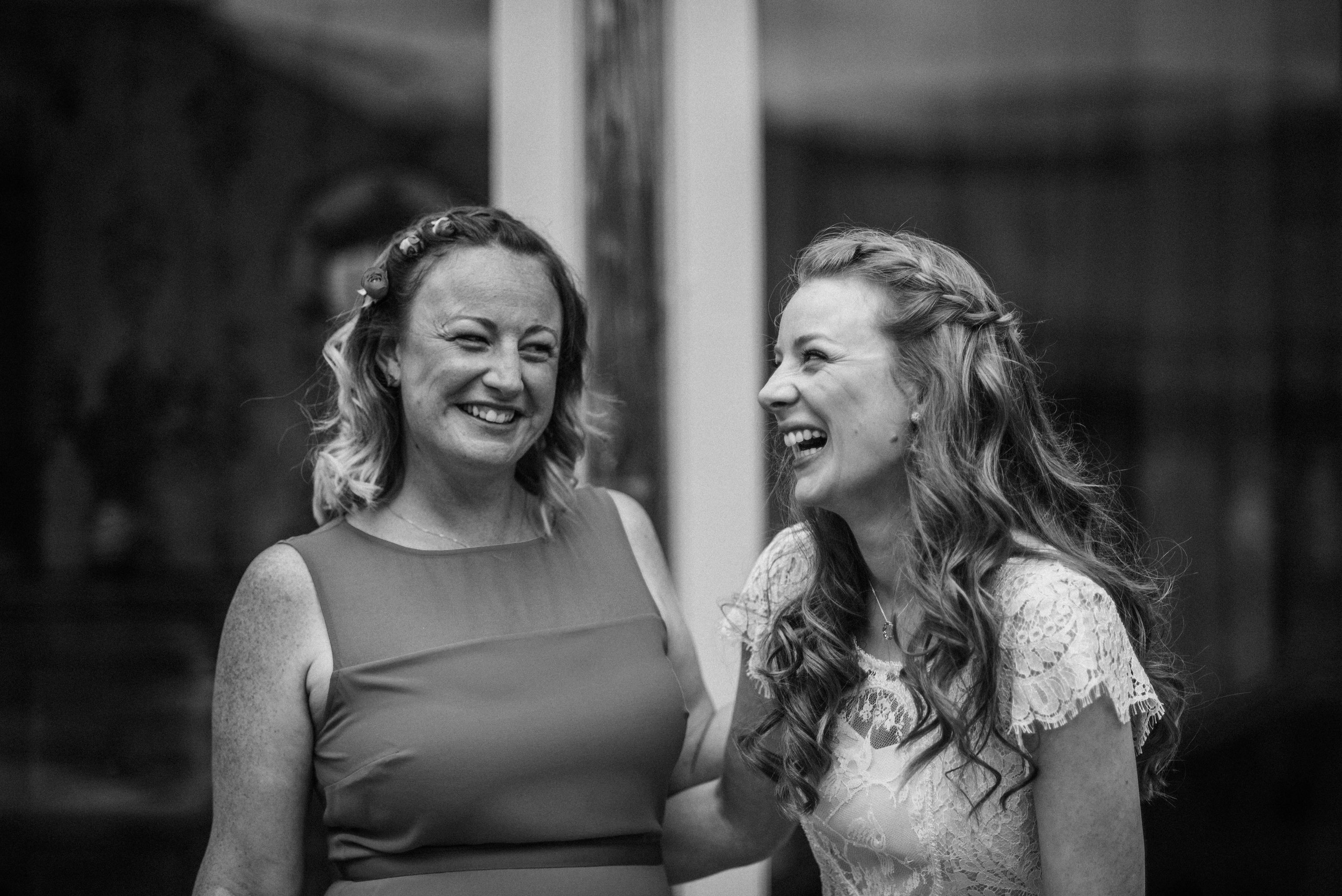 Bride laughs with sister Cliff Barns Norfolk essex UK Documentary Wedding Photographer