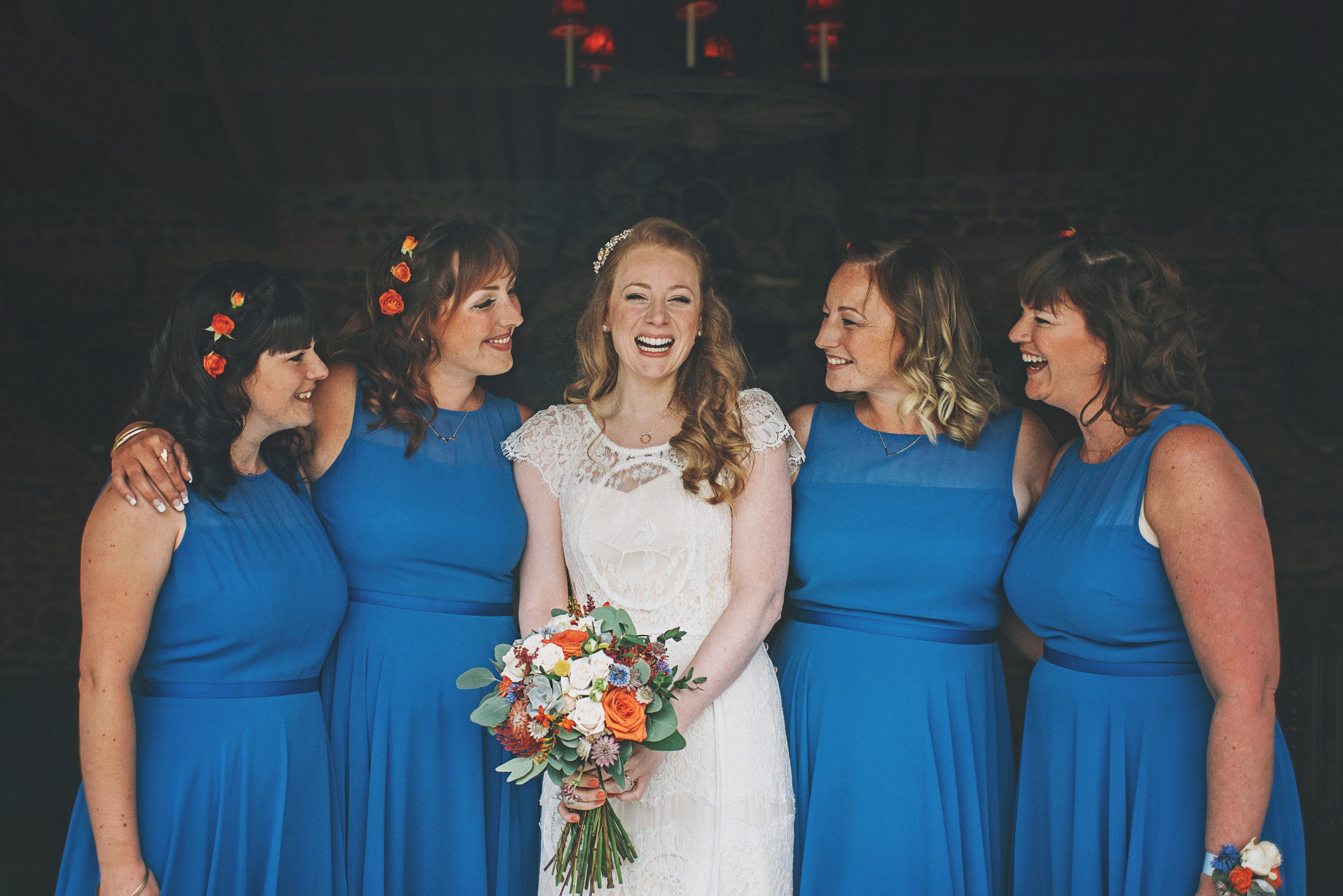 Bride and Bridesmaids in Blue Mexican Theme Cliff Barns Norfolk Essex UK Documentary Wedding Photographer