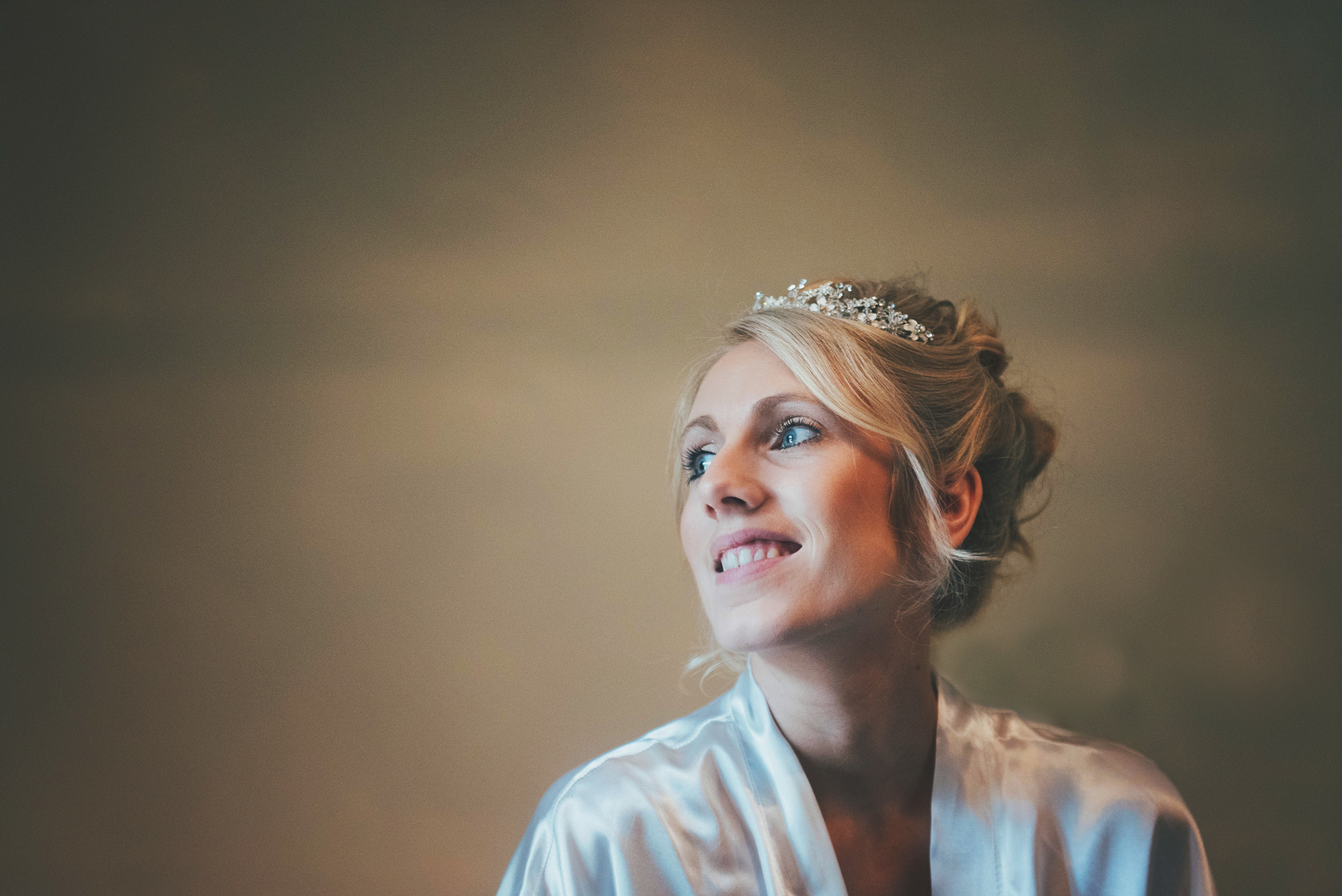 bride in dressing gown rustic Blake Hall essex uk documentary wedding photographer