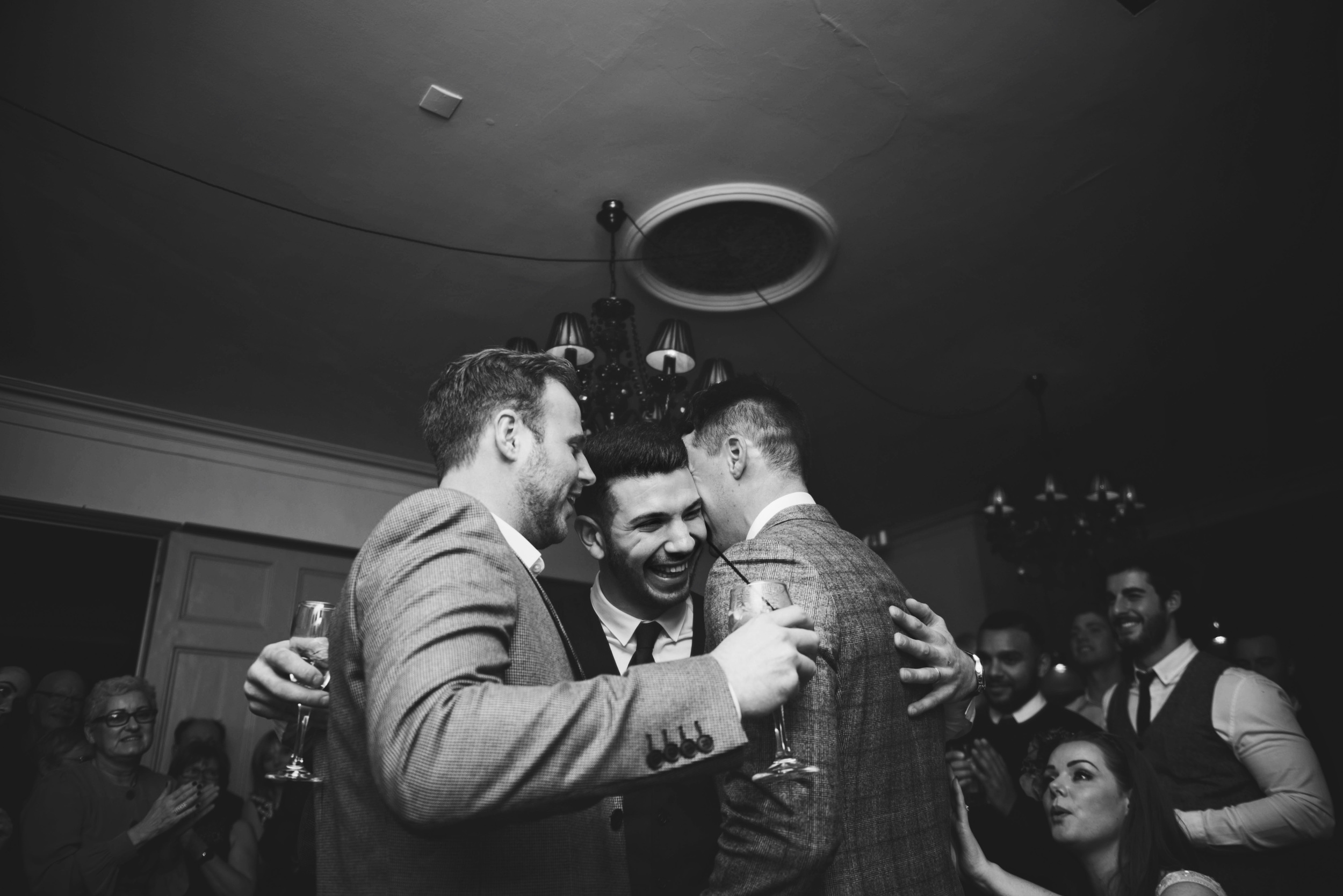 Groom hugs friends Vintage London Pub Essex UK Documentary Wedding Photographer