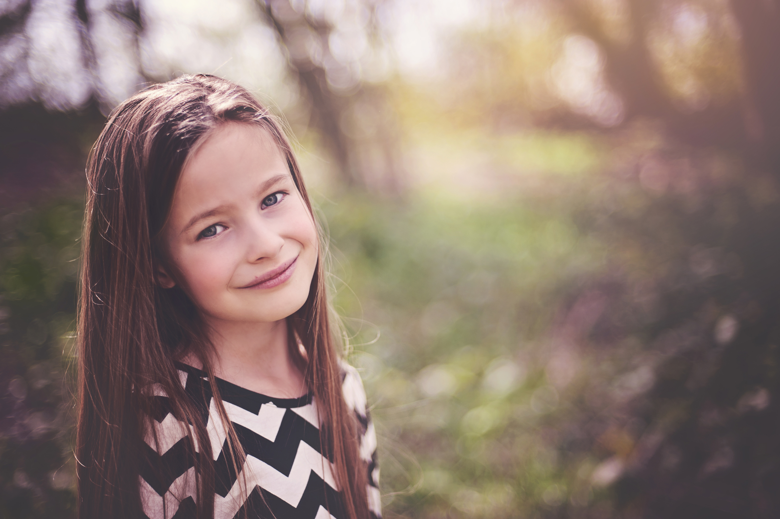 Little girl in Bluebell Wood Essex UK Documentary Portrait and Lifestyle Photographer