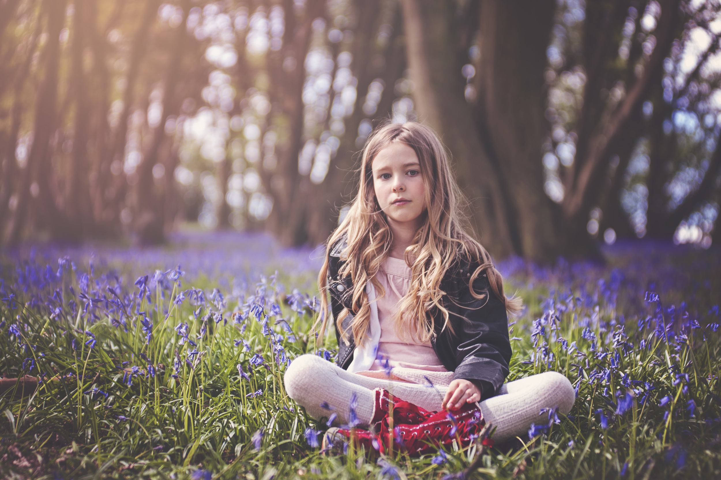 Young girl in Bluebell Wood Essex UK Documentary Portrait and Lifestyle Photographer