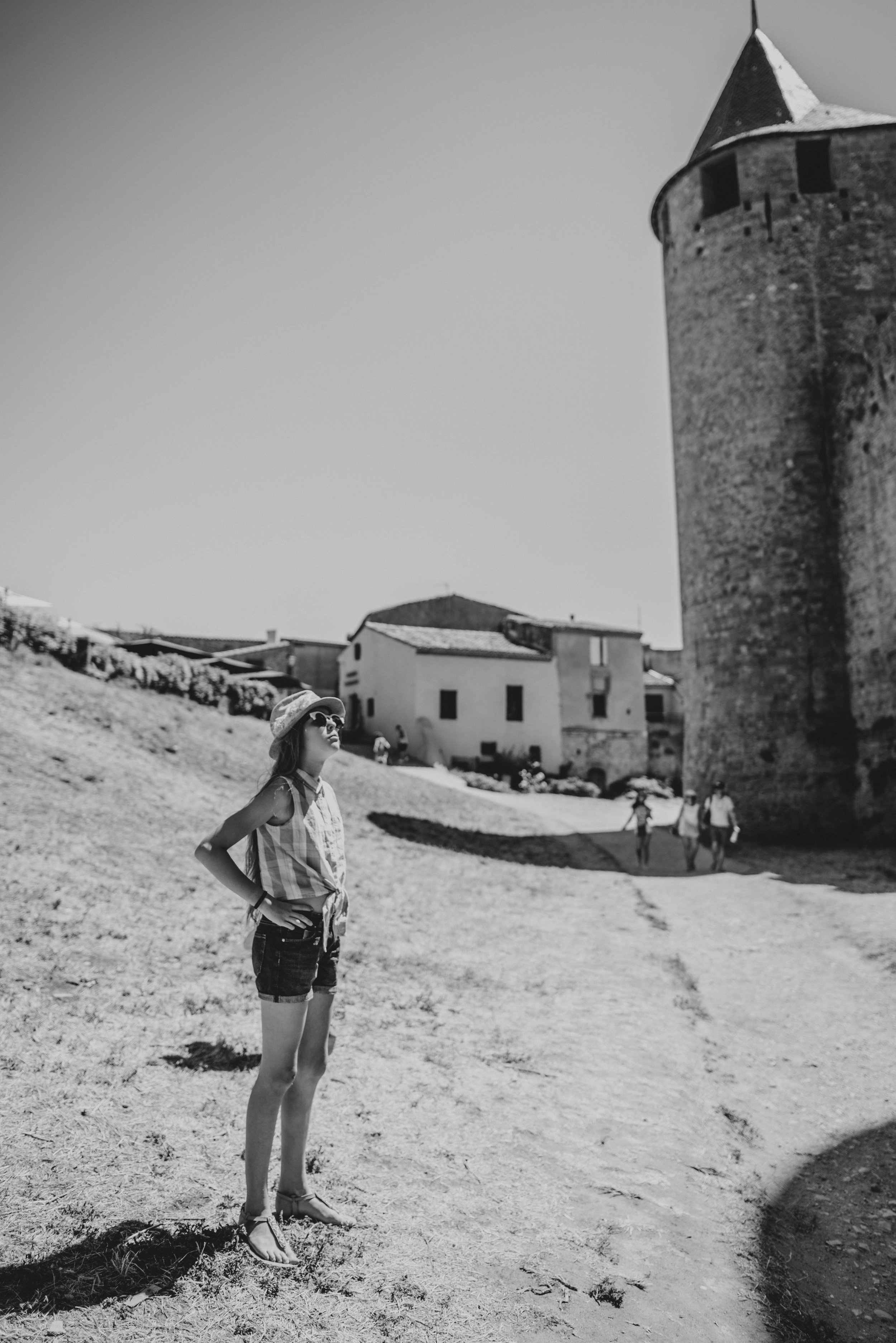 Young girl looks up at Citadel Carcassonne France Essex UK Documentary Photographer
