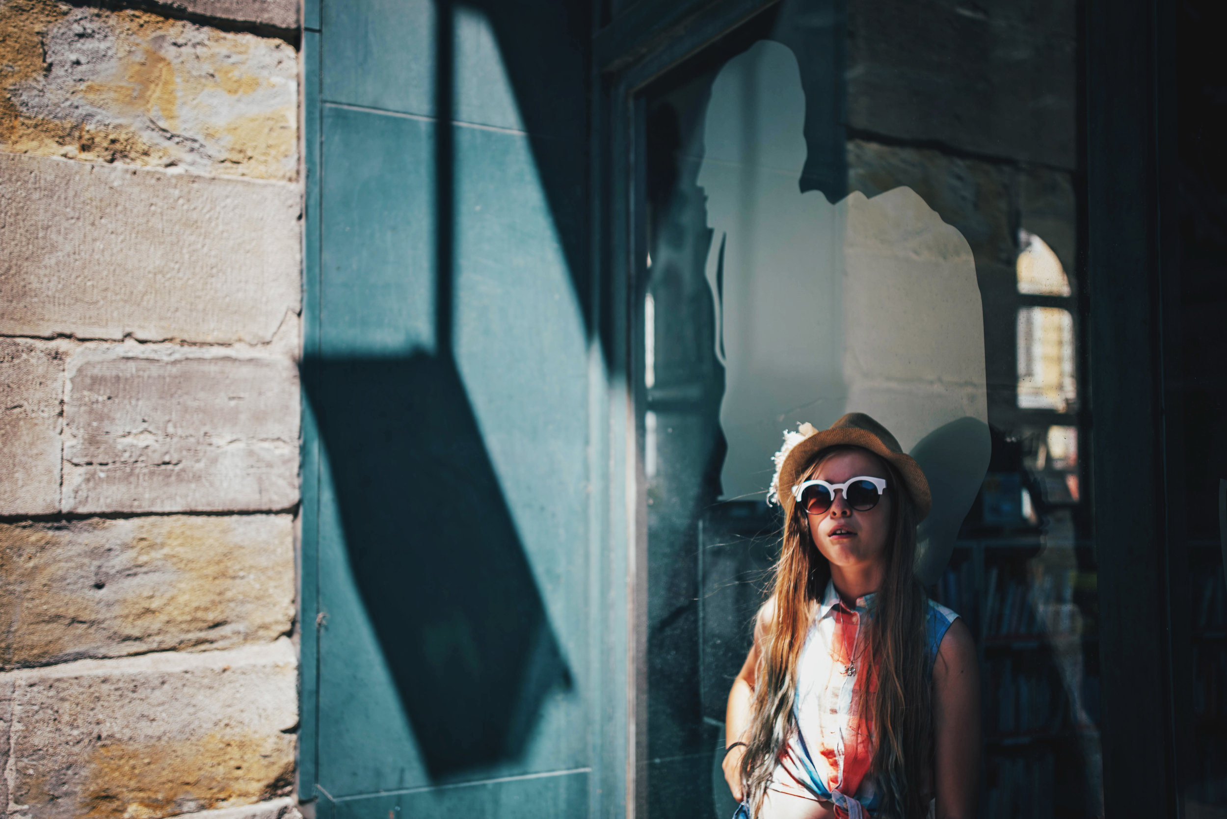 Girl stands in the shade in Carcassonne France Essex UK Documentary Photographer