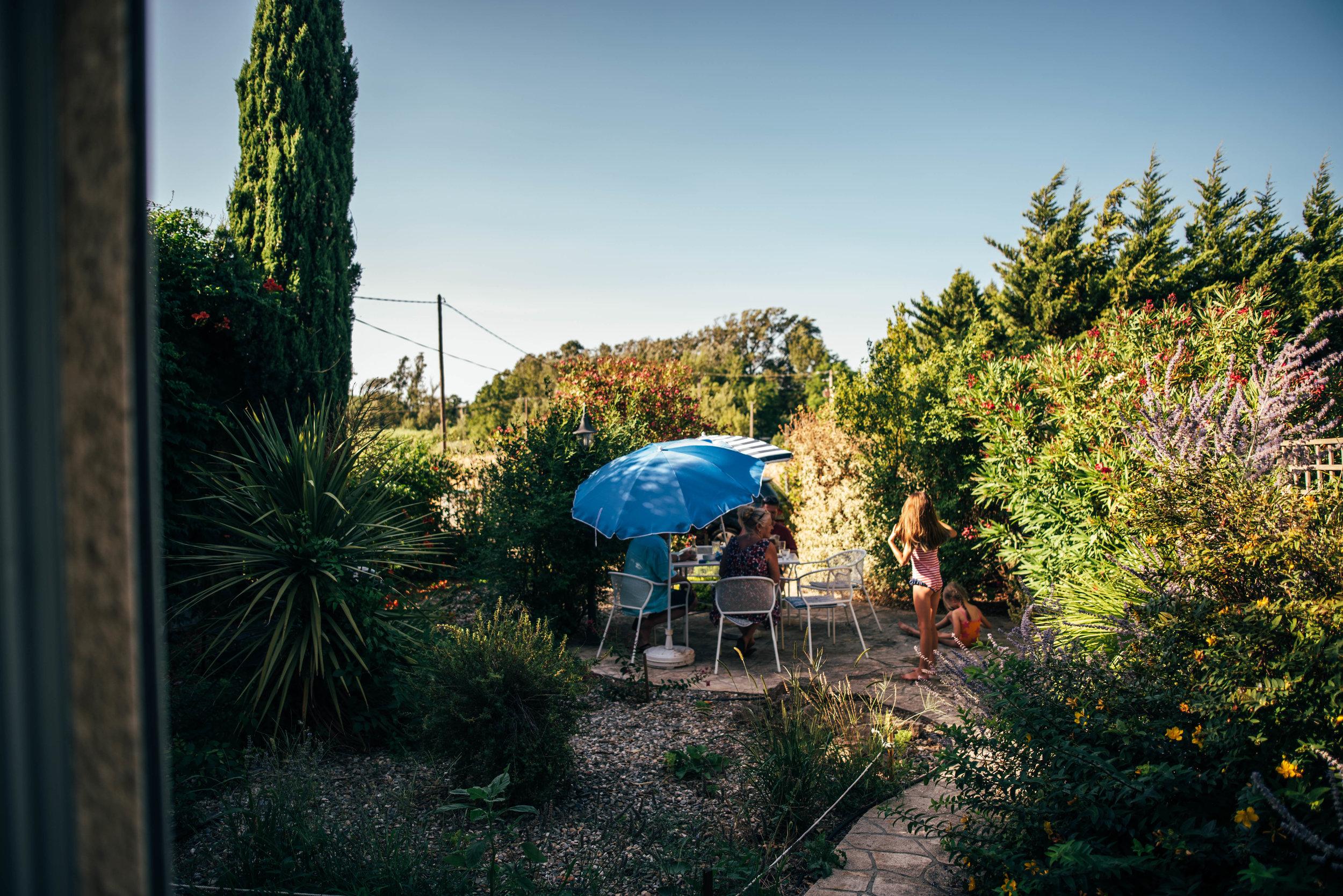 Family in garden Essex UK Documentary Photographer