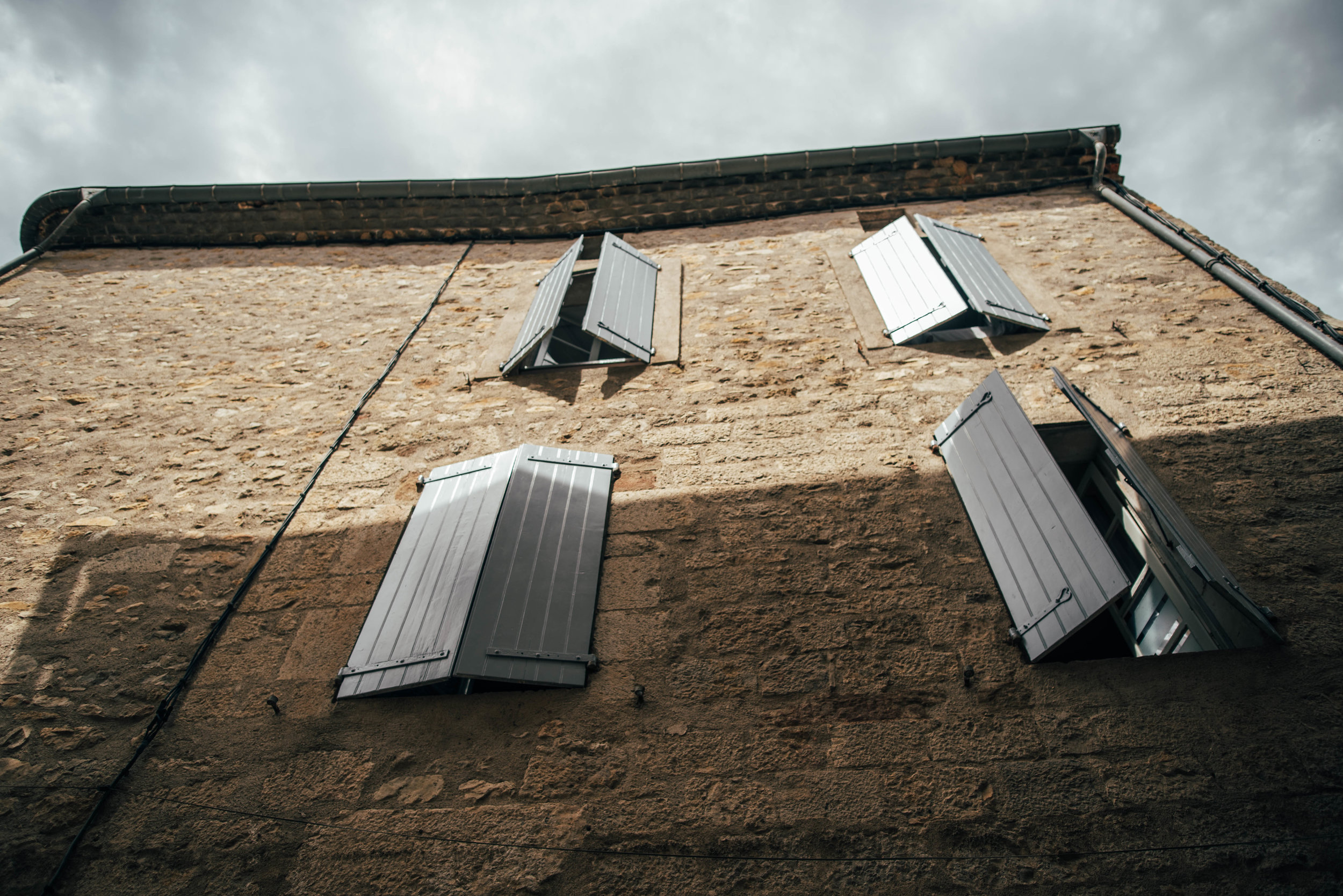 House with shutters in Lagrasse France Essex UK Documentary Photographer