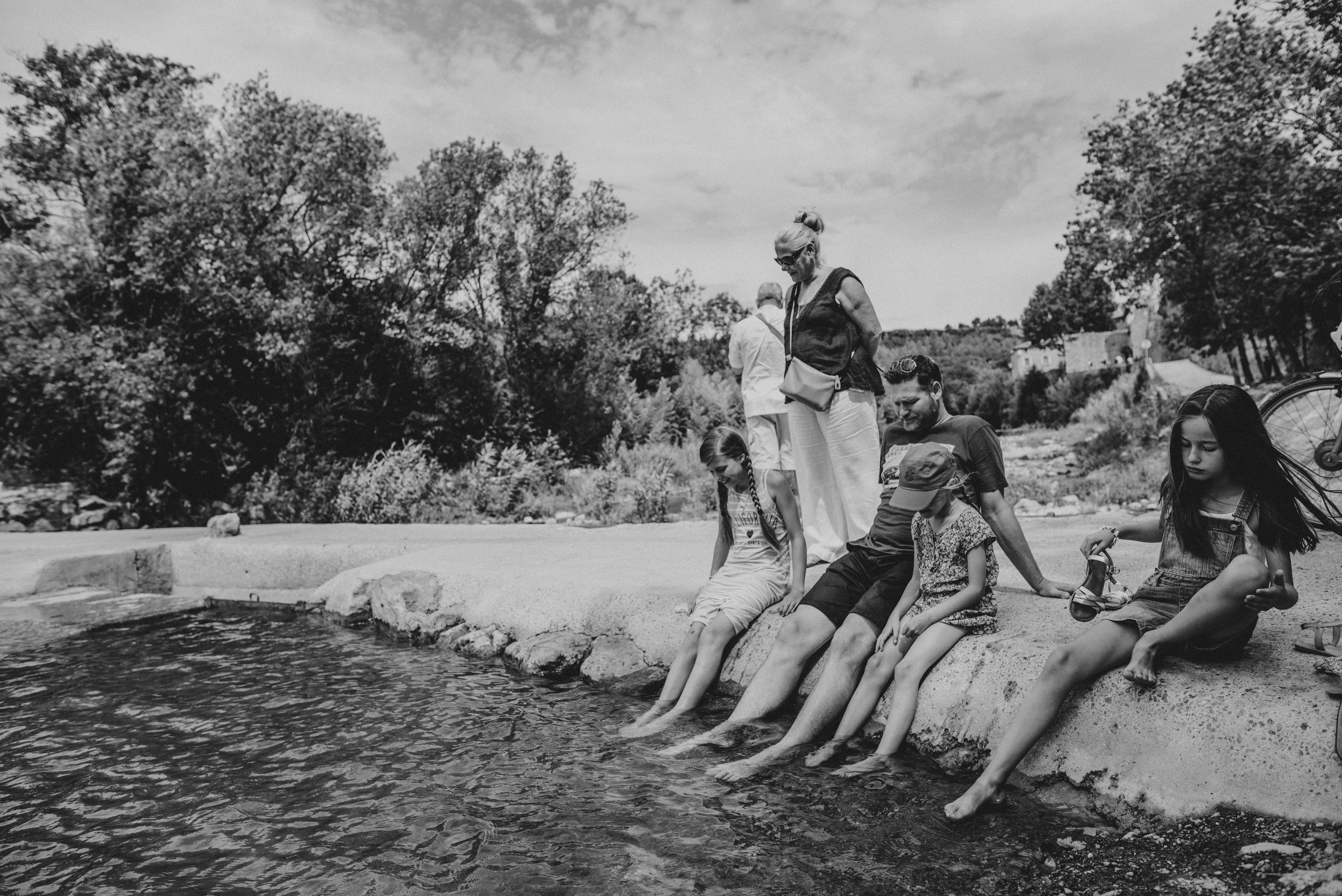 Family paddle in river in Lagrasse France Essex UK Documentary Portrait Photographer