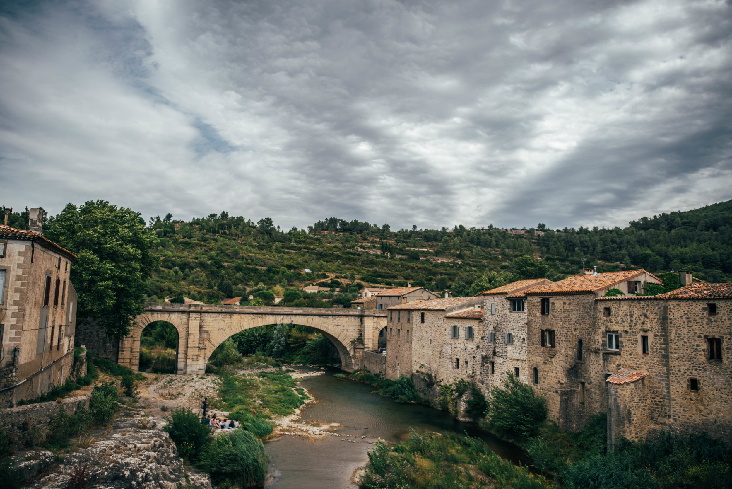 View of Lagrasse France from bridge over river Essex UK Documentary Photographer