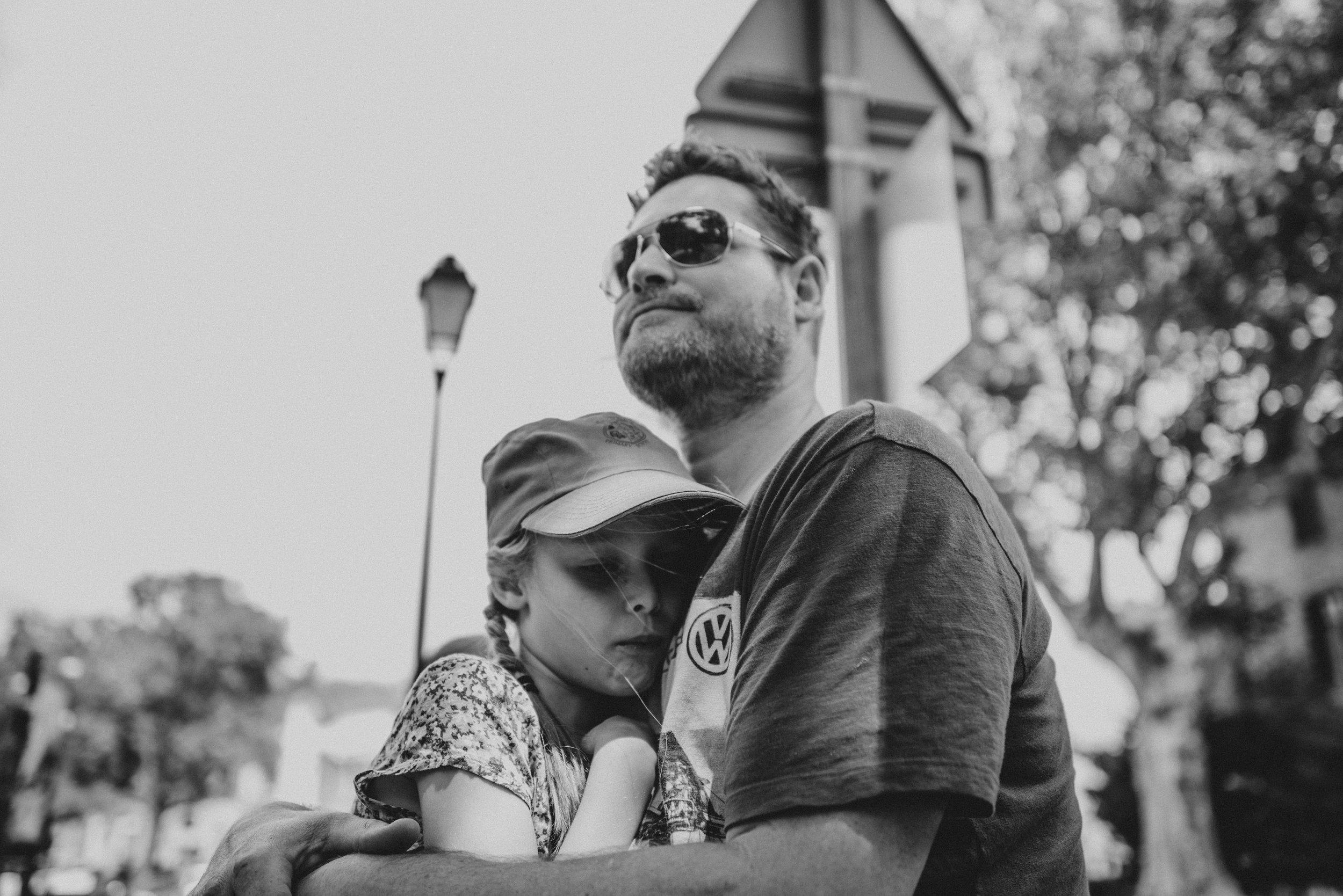 Young girl hugs dad Essex UK documentary Portrait Photographer
