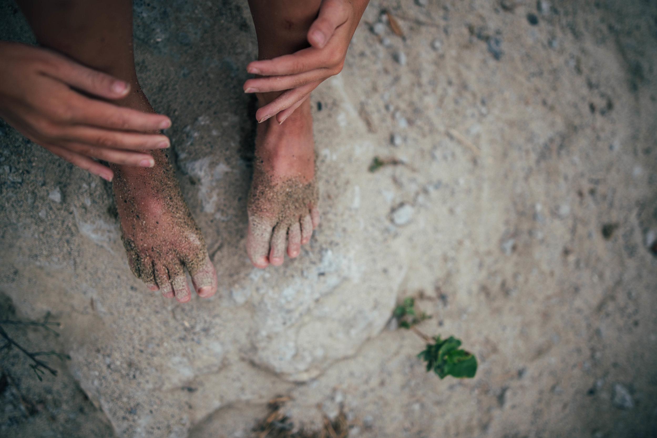 Girls sandy feet and hands Essex UK Documentary Portrait Photographer