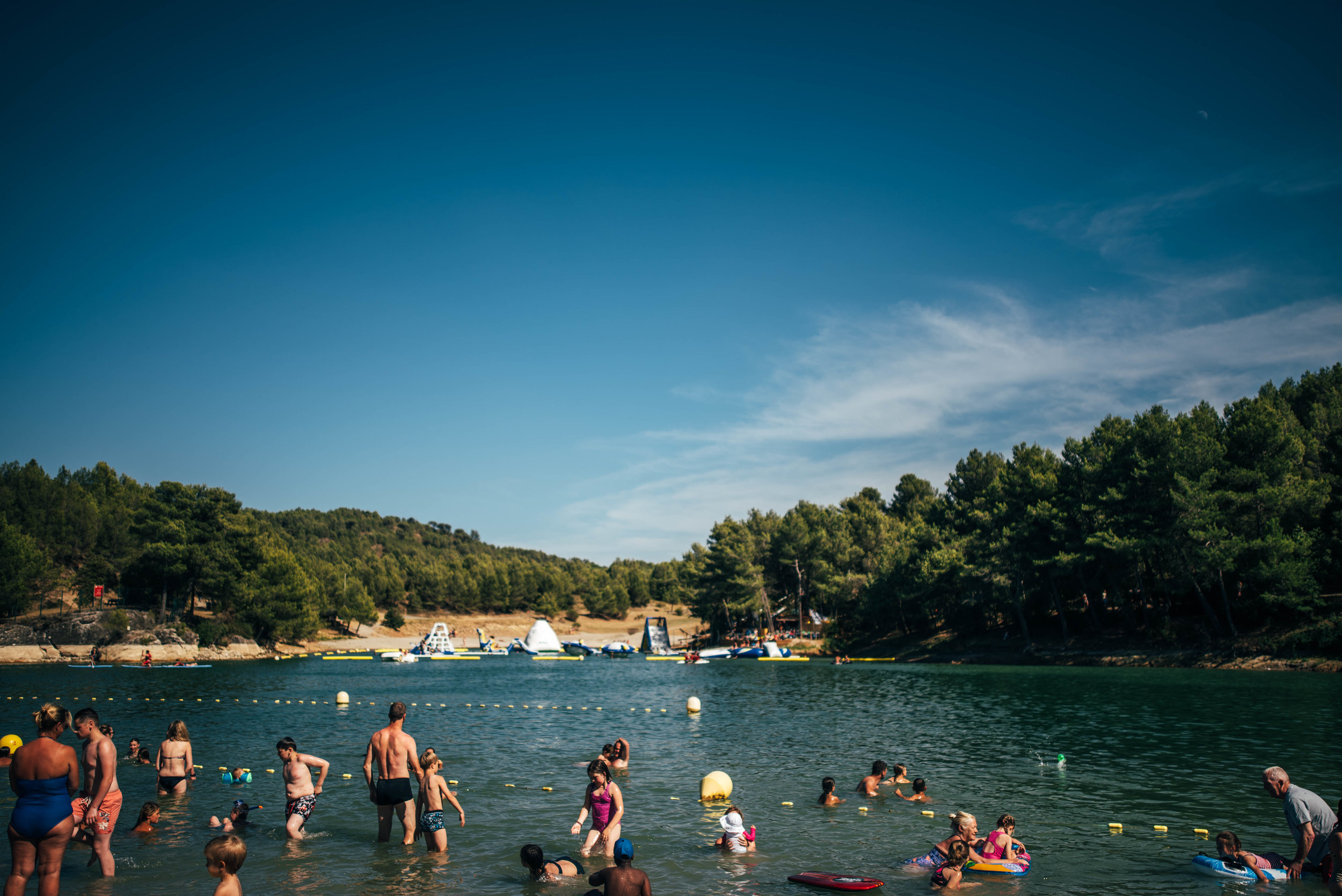 Families swimming in Lake France Essex UK Documentary Photographer