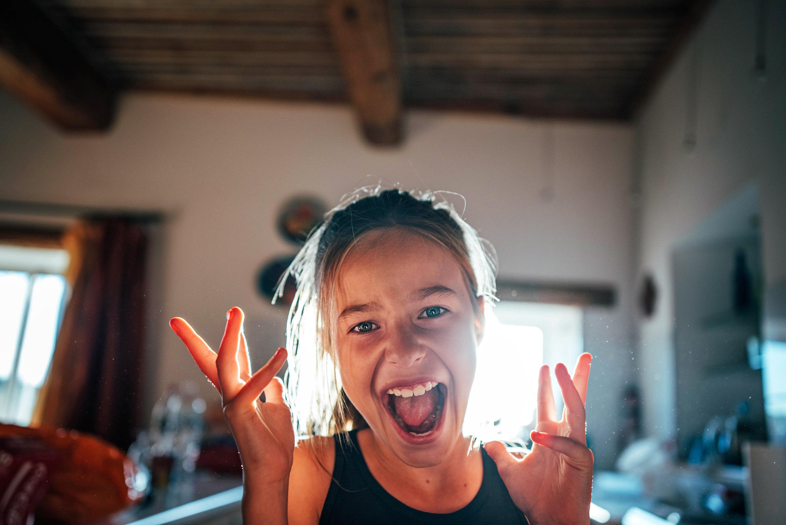 Girl dances in kitchen Essex UK Documentary Portrait Photographer