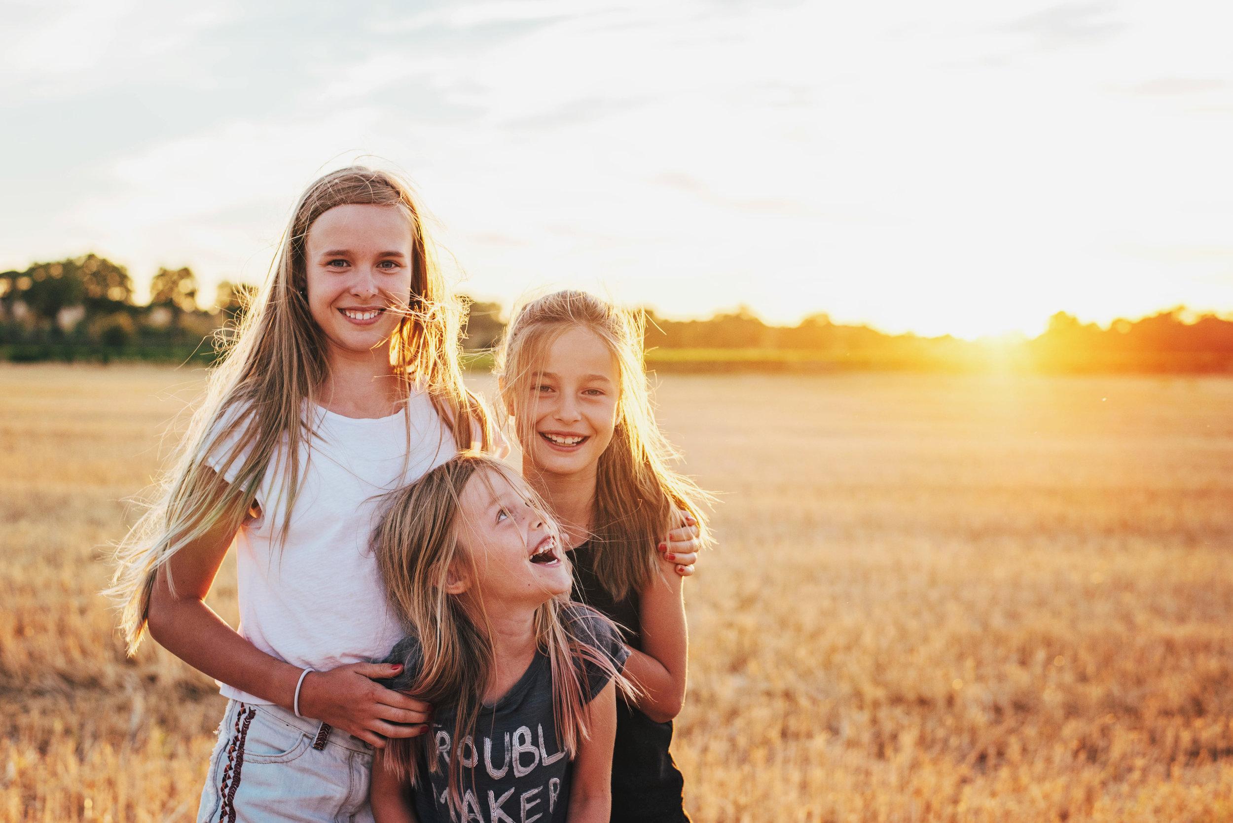 Three girls in cornfield at sunset Essex UK Documentary Portrait Photographer