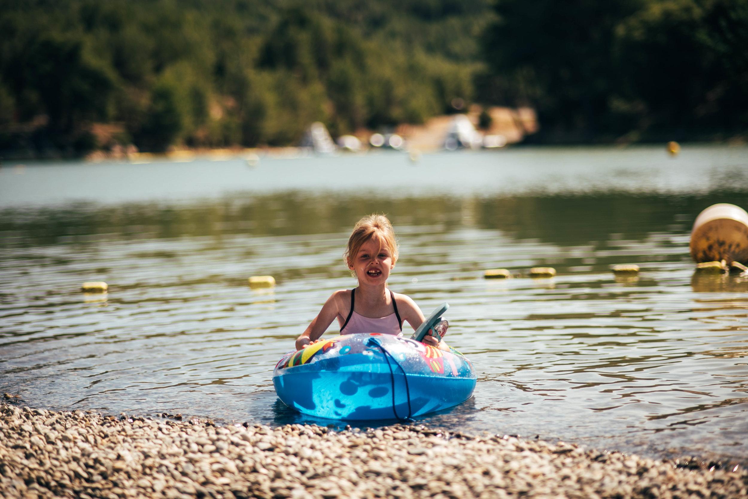 Little girl in boat on lake Essex uK Documentary Portrait Photographer