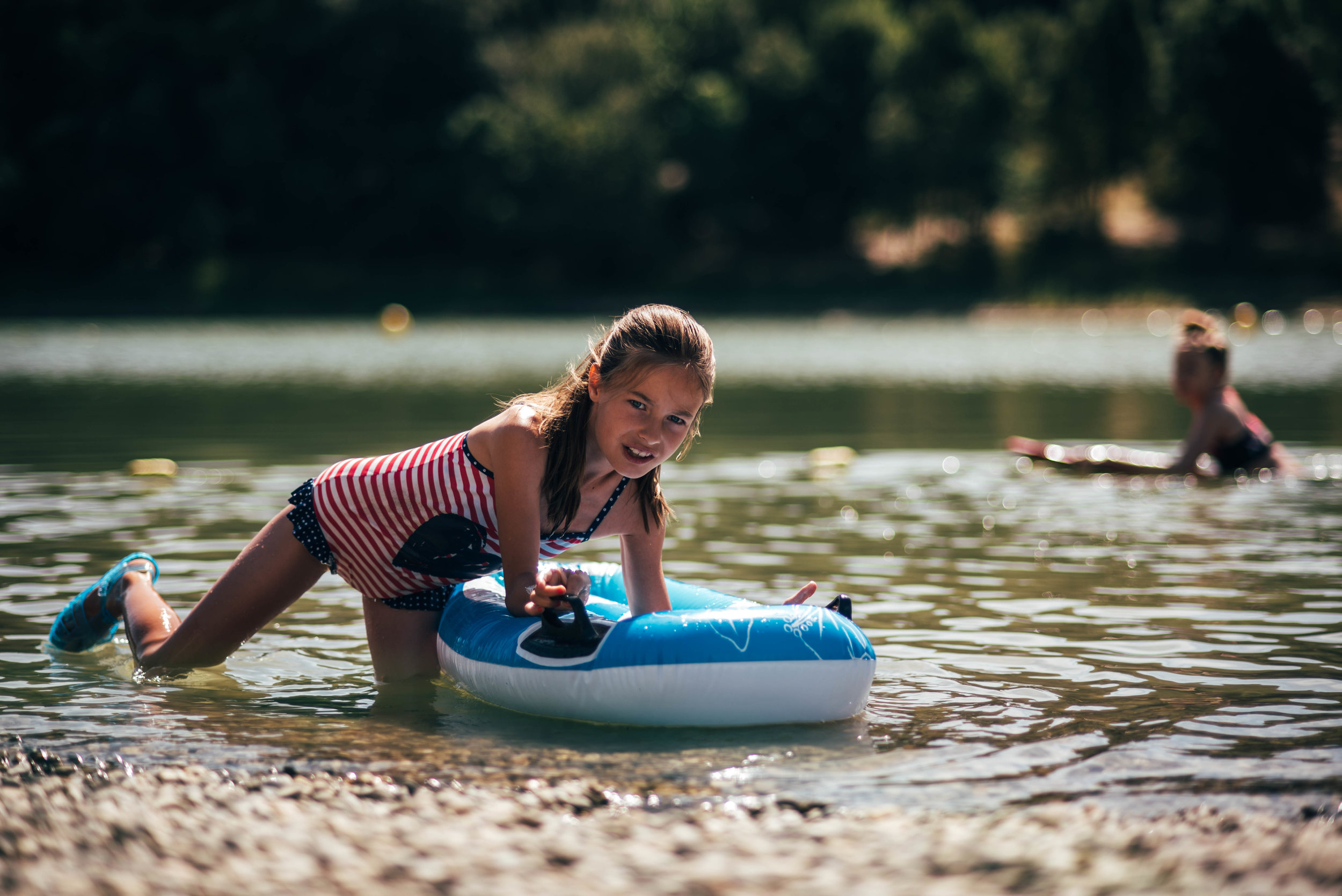 Young girl in boat on lake Essex UK Documentary Portrait Photographer