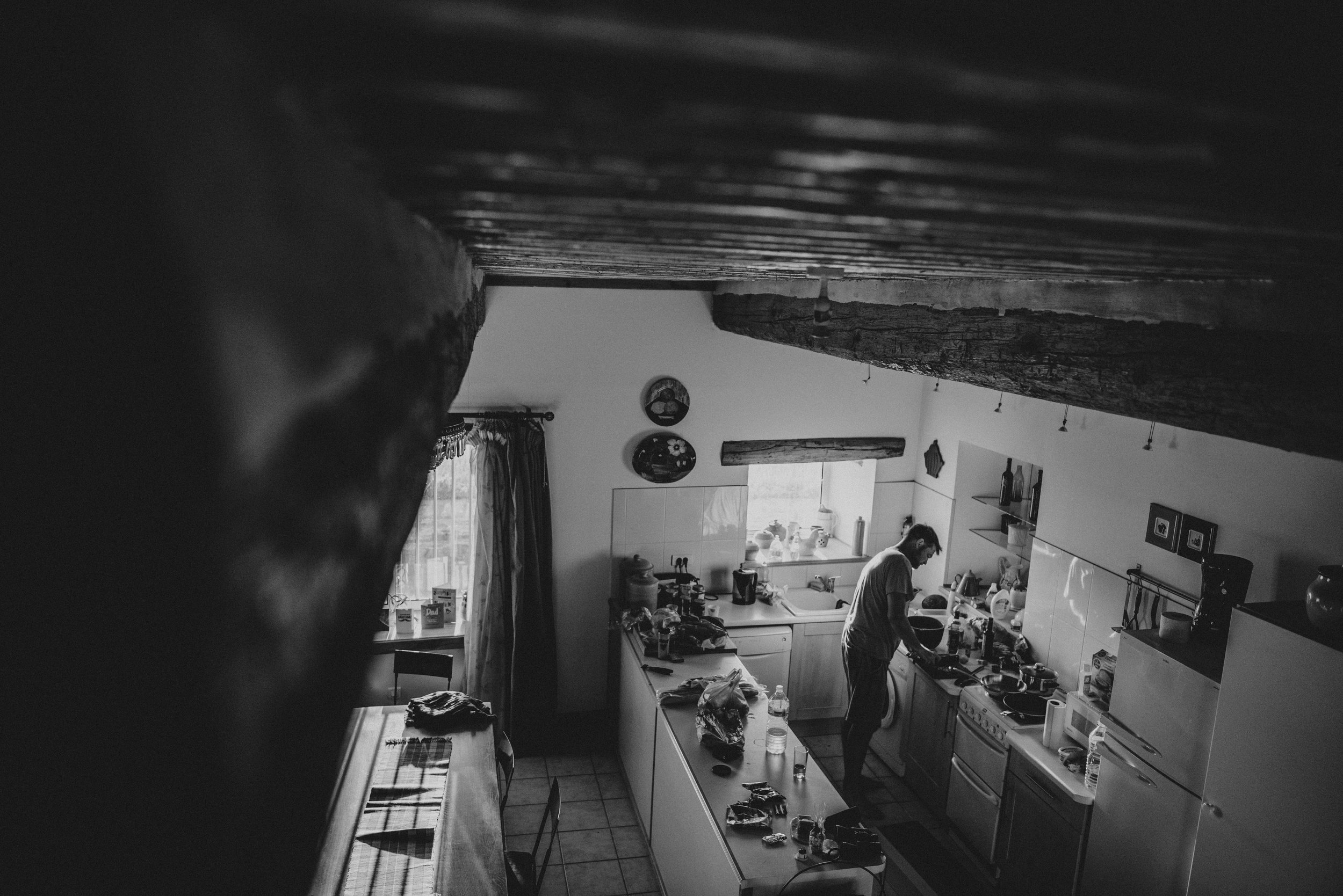 Dad prepares dinner in country house kitchen Essex UK Documentary Photographer
