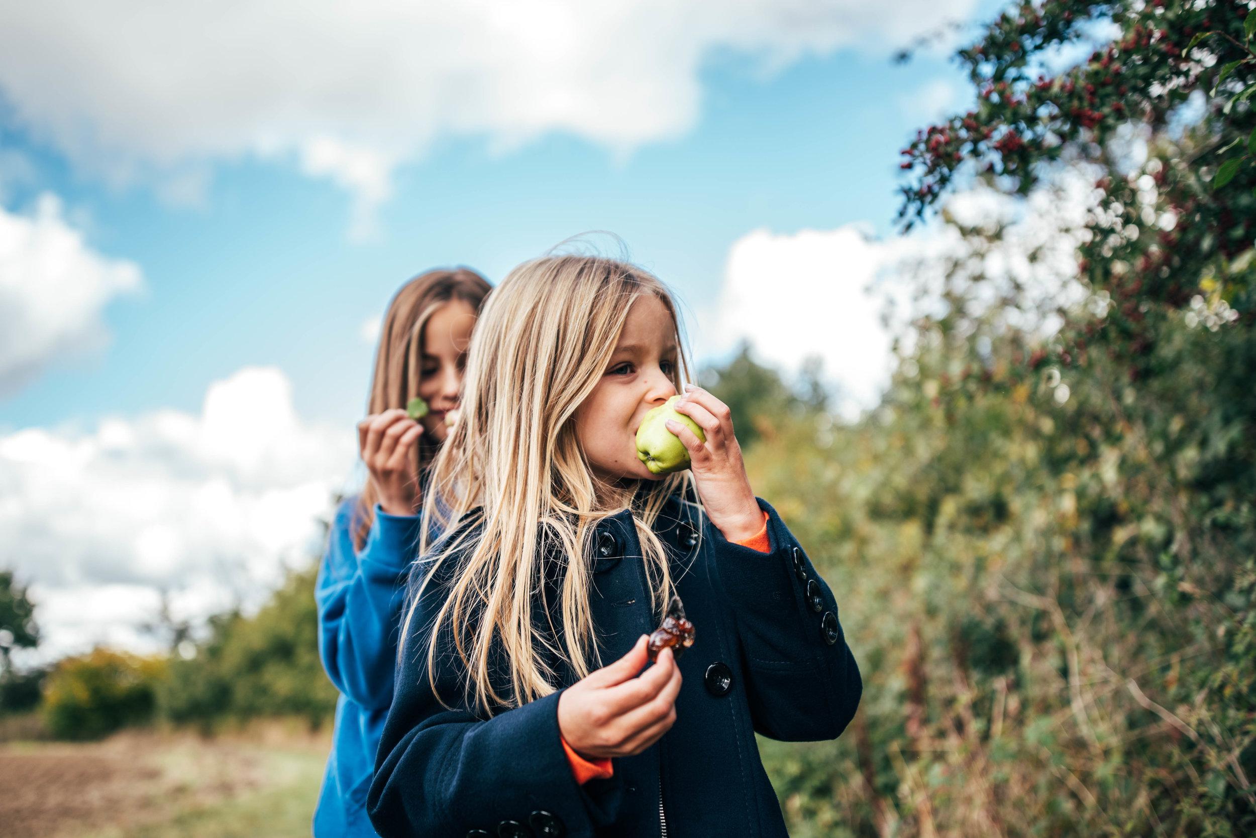 Girls eat apples Essex UK Documentary Portrait Photographer