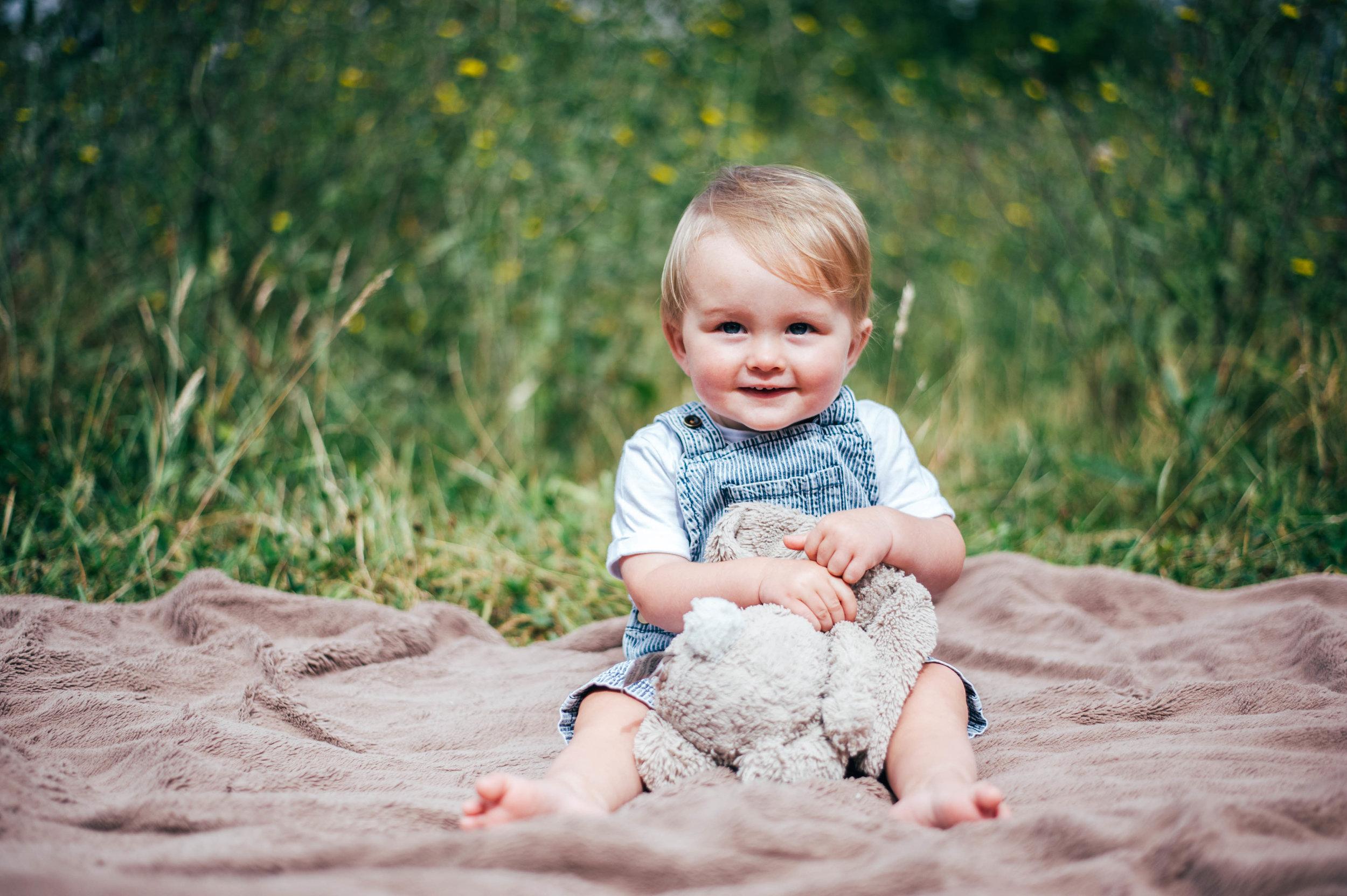 Baby boy on blanket with teddy Essex UK Documentary Portrait Photographer