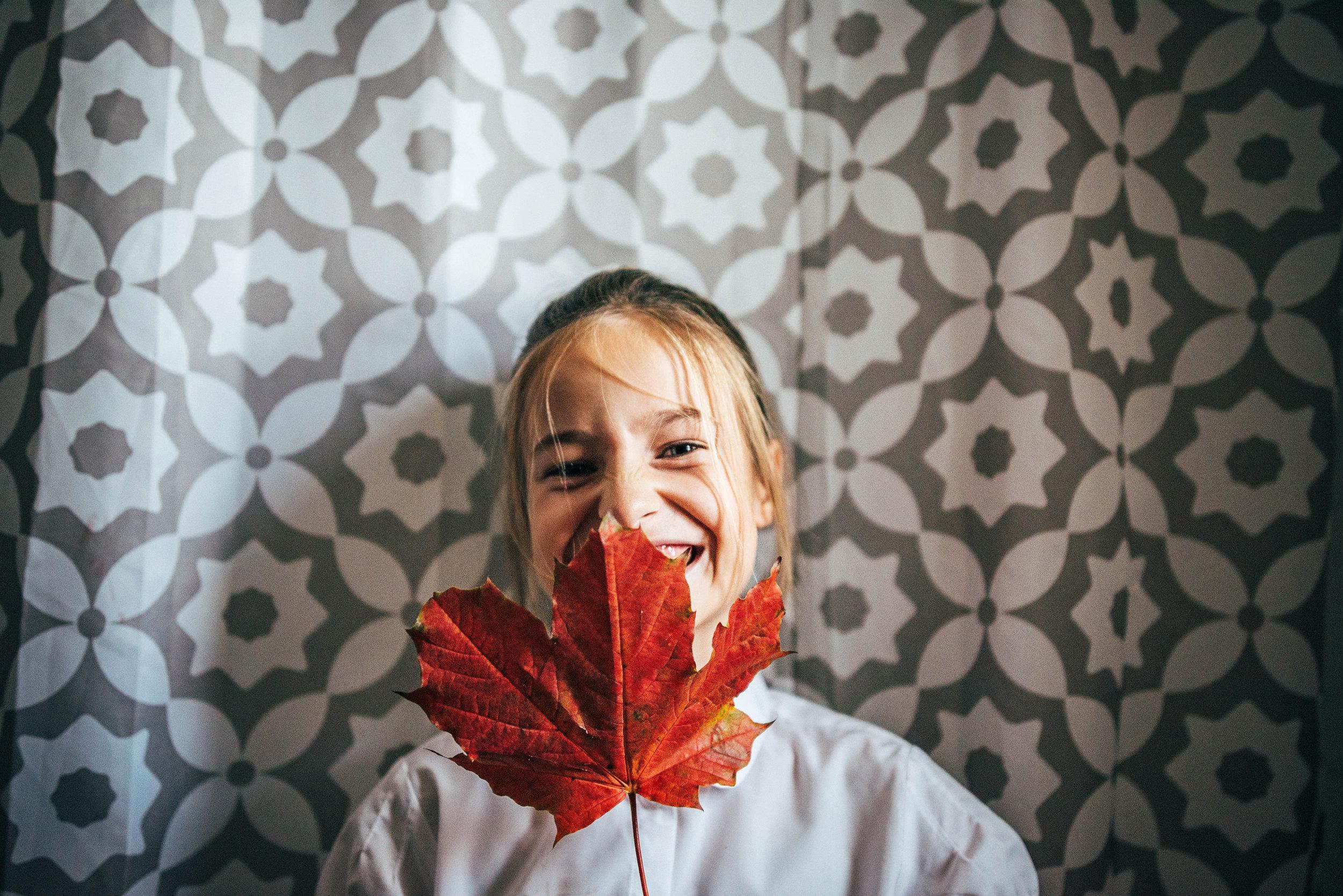 Little girl with Autumn Leaf Essex UK Documentary Lifestyle Portrait Photographer