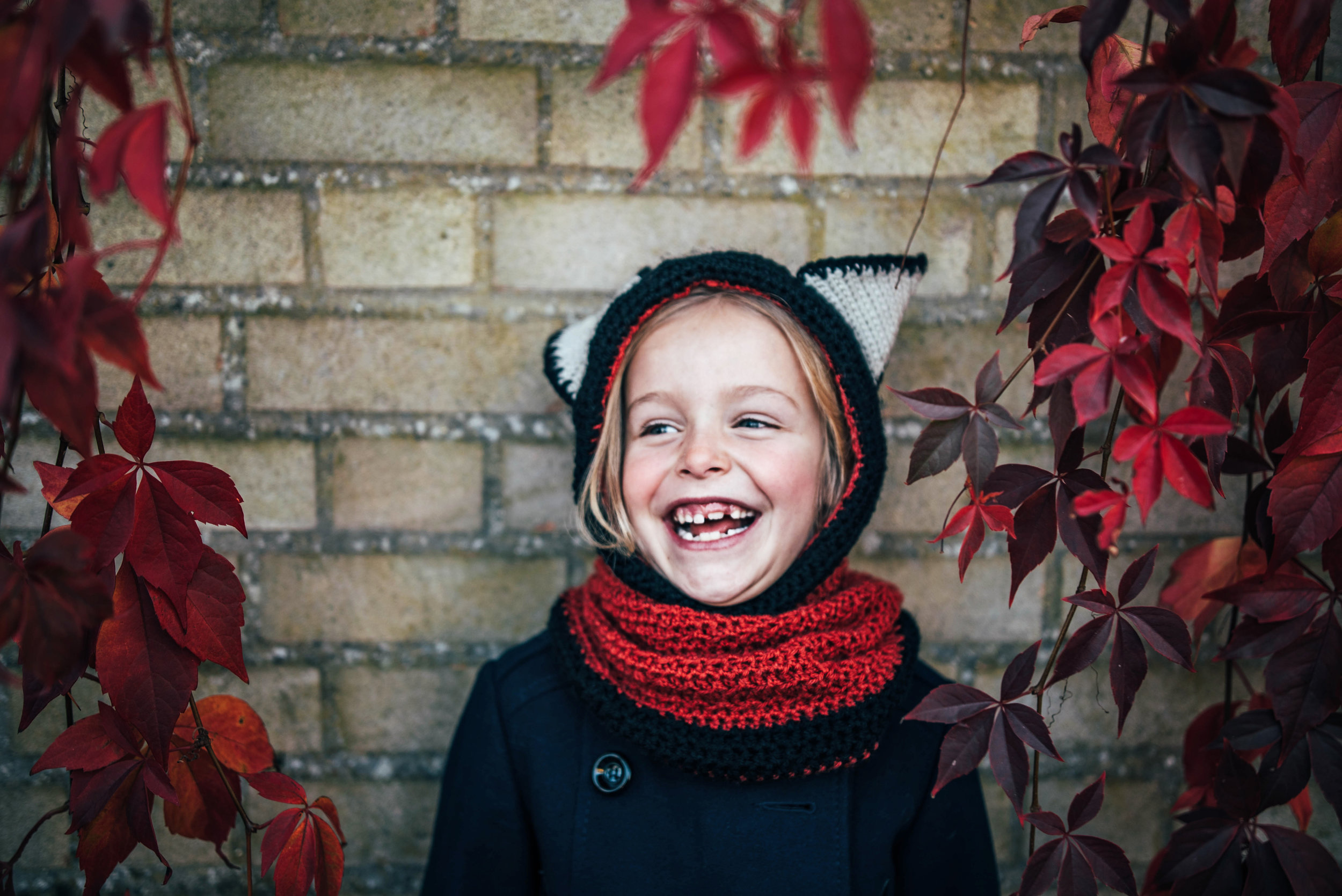 Little girl in Fox hat Autumn Leaves Essex UK Documentary Portrait Photographer