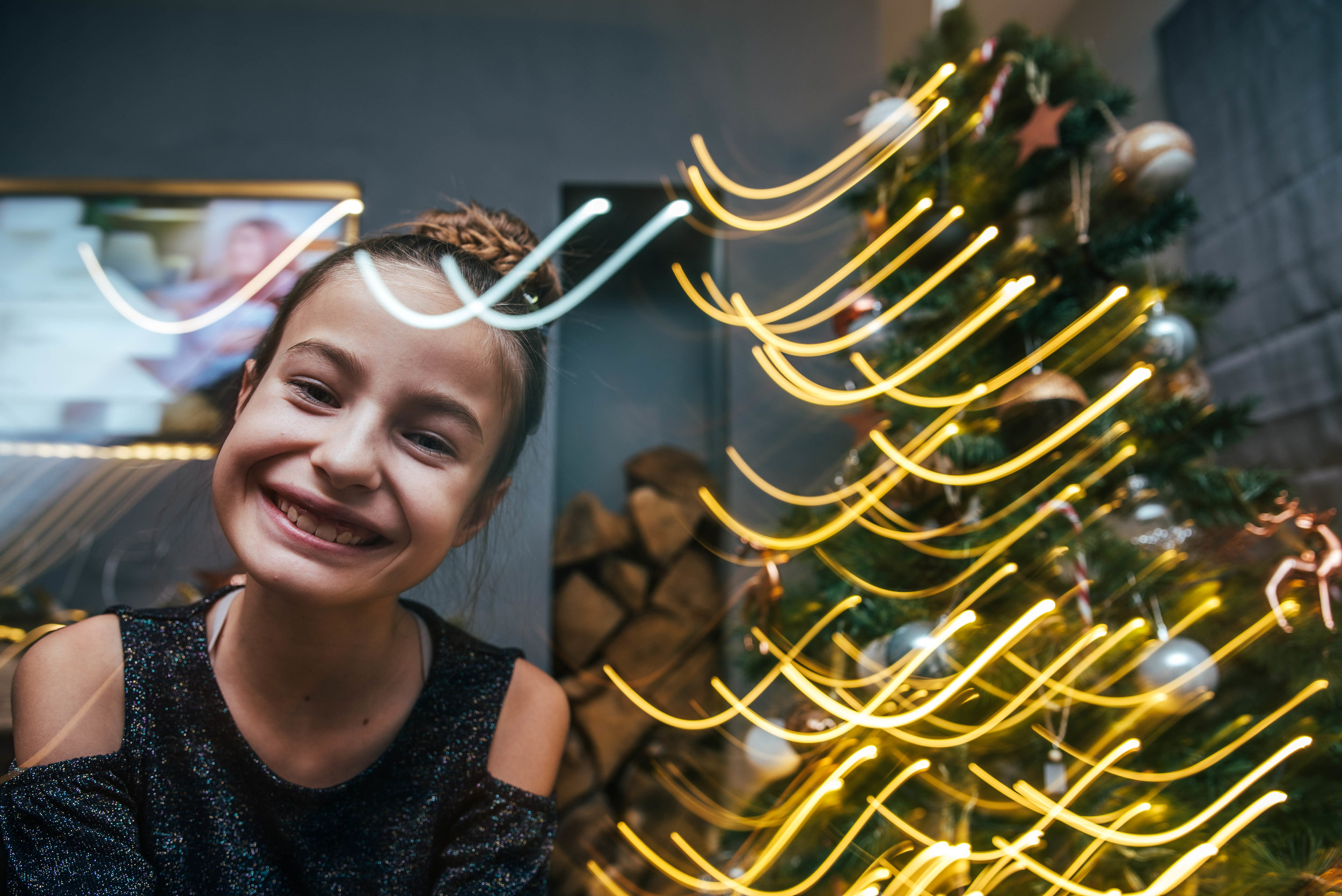 Girl with light trails by Christmas Tree Essex UK Documentary Photographer
