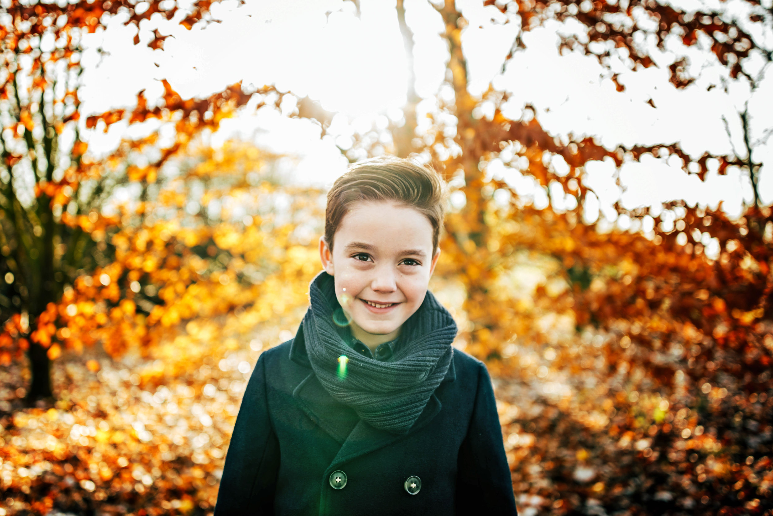 Young boy in Autumn light Essex UK Family Childhood Lifestyle Documentary Photographer