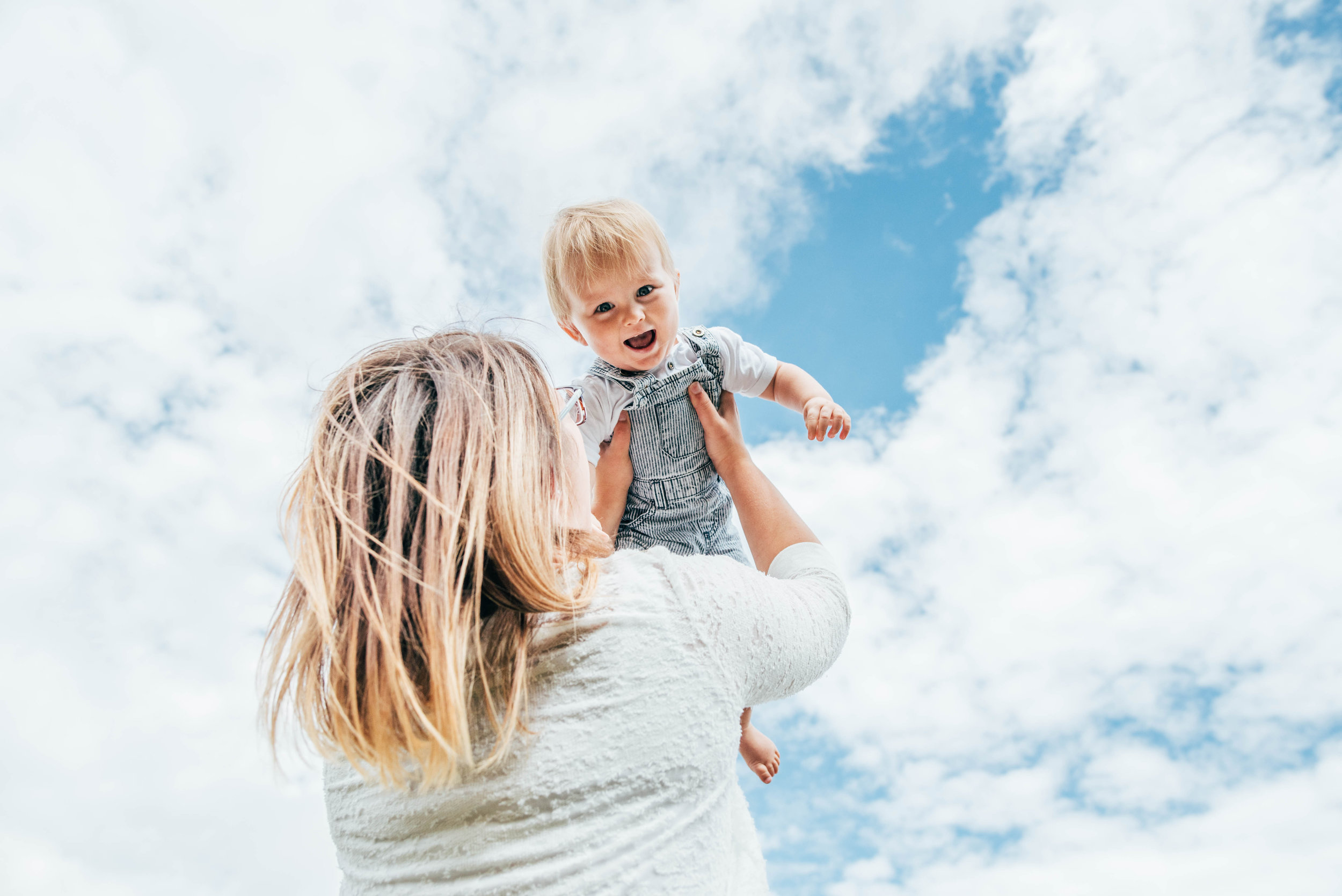 mum holds baby up to the sky essex uk documentary lifestyle family childhood photographer