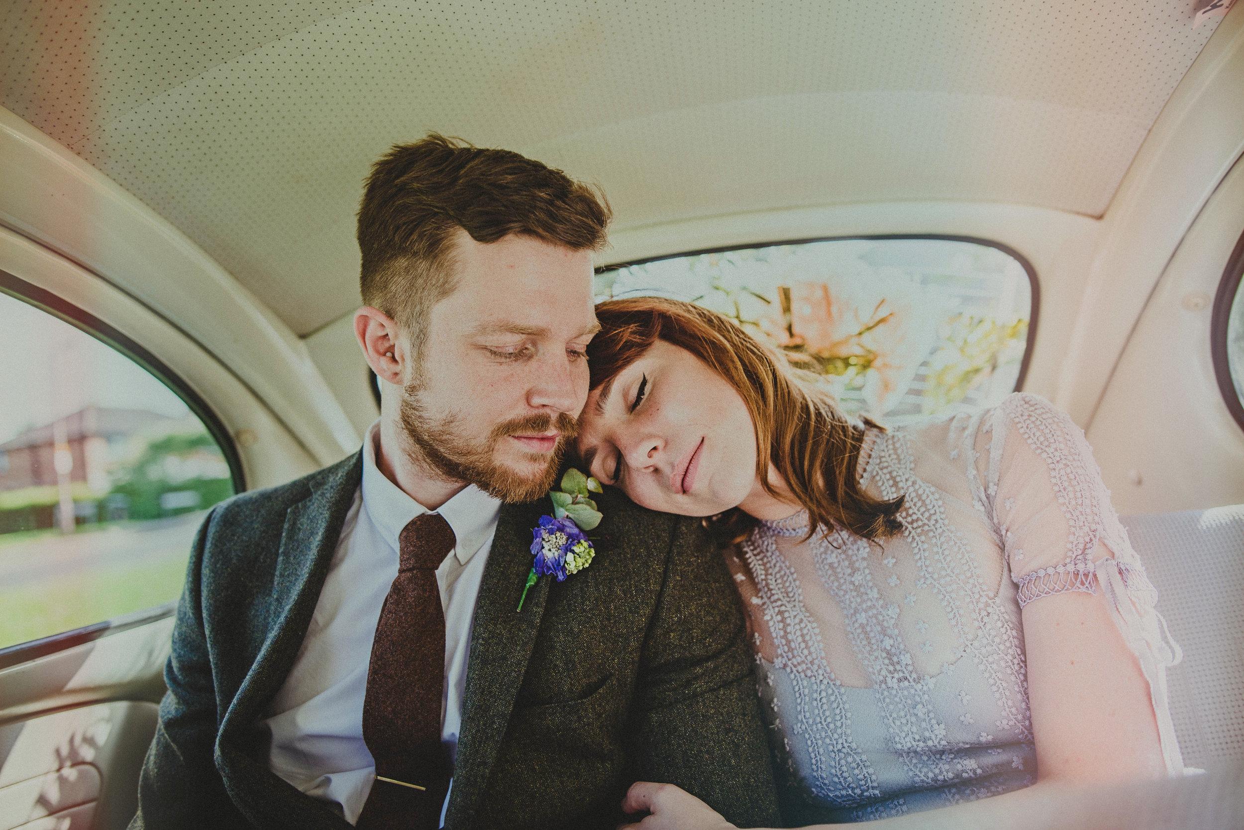 Bride and Groom in car Hutton Poplars Essex Documentary Wedding Photographer