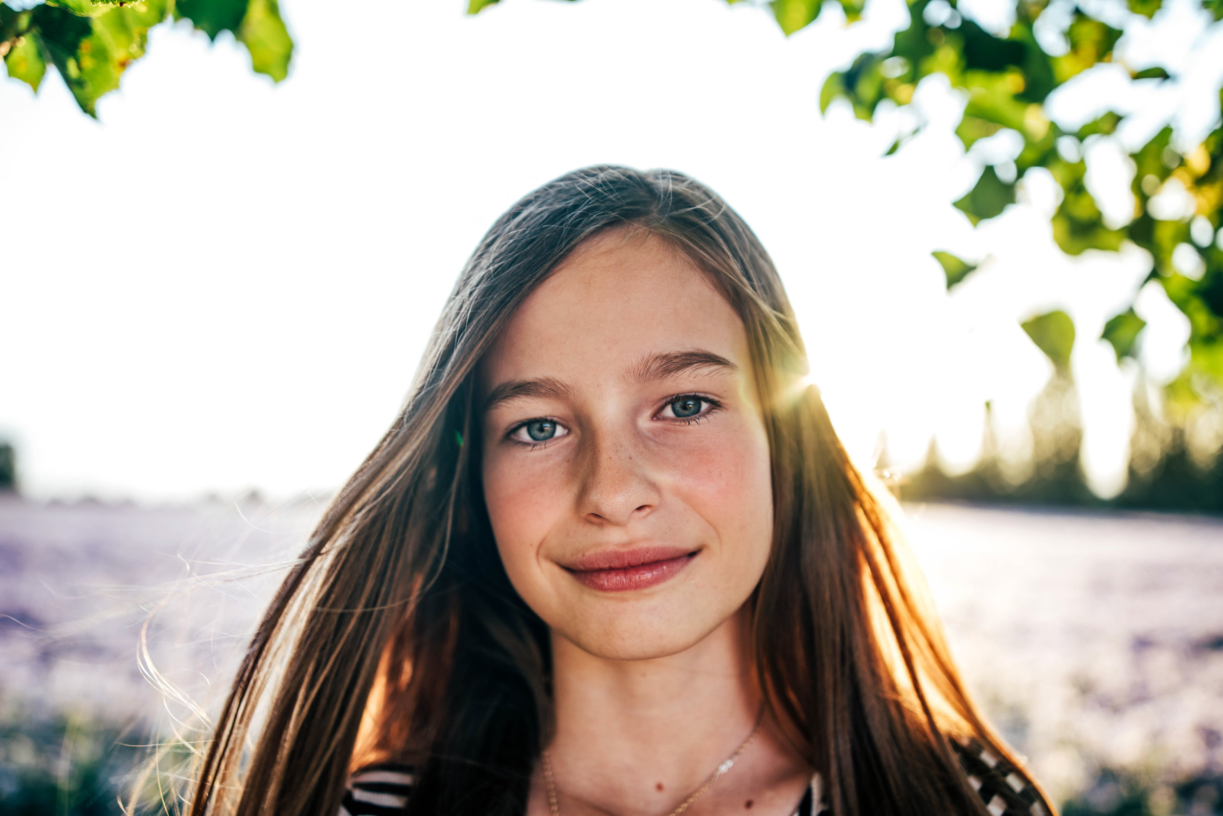 tween girl in purple field at sunset Essex UK Documentary Portrait Photographerw