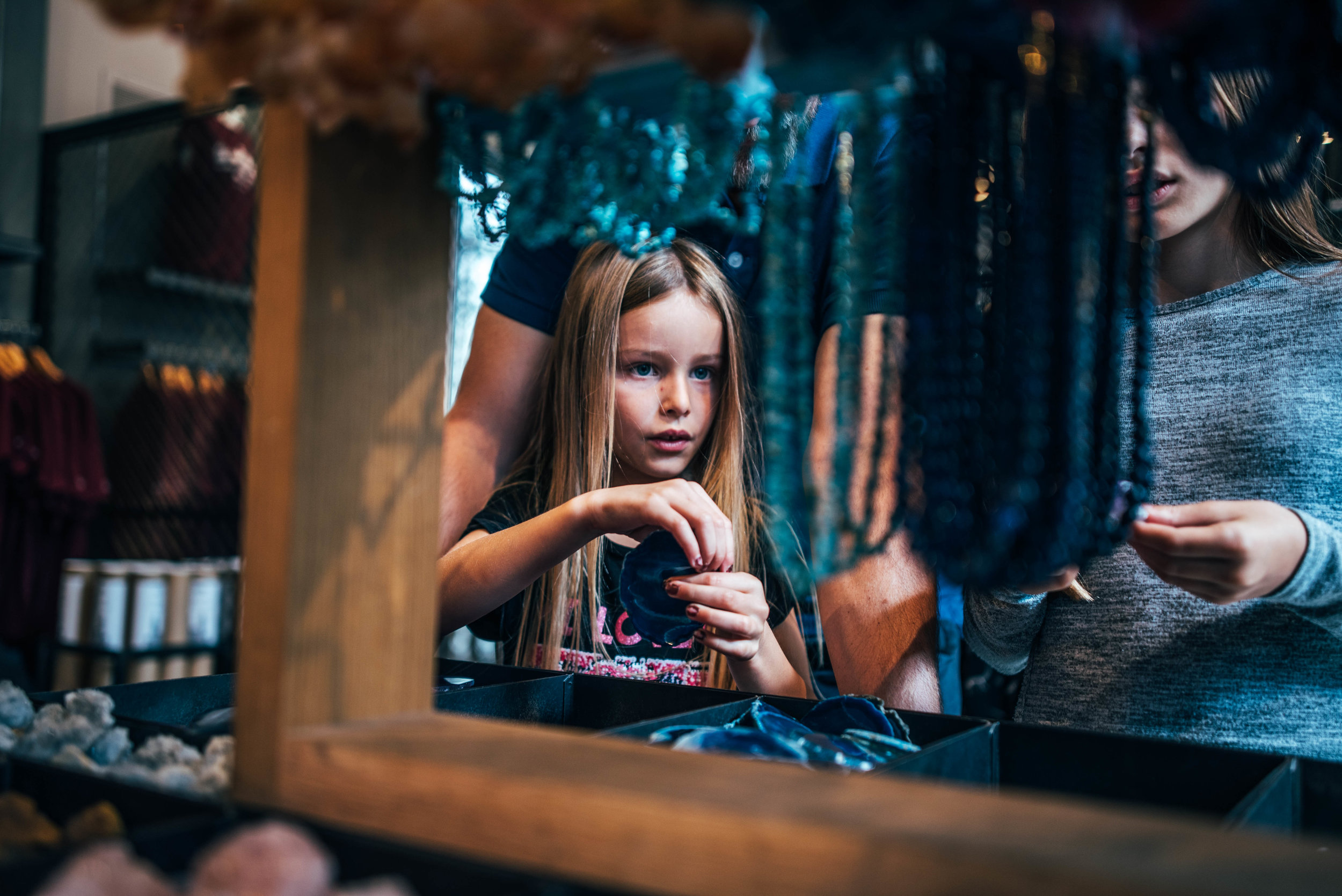 Young girl in shop at London Natural History Museum Essex UK Documentary Lifestyle Wedding Photographer