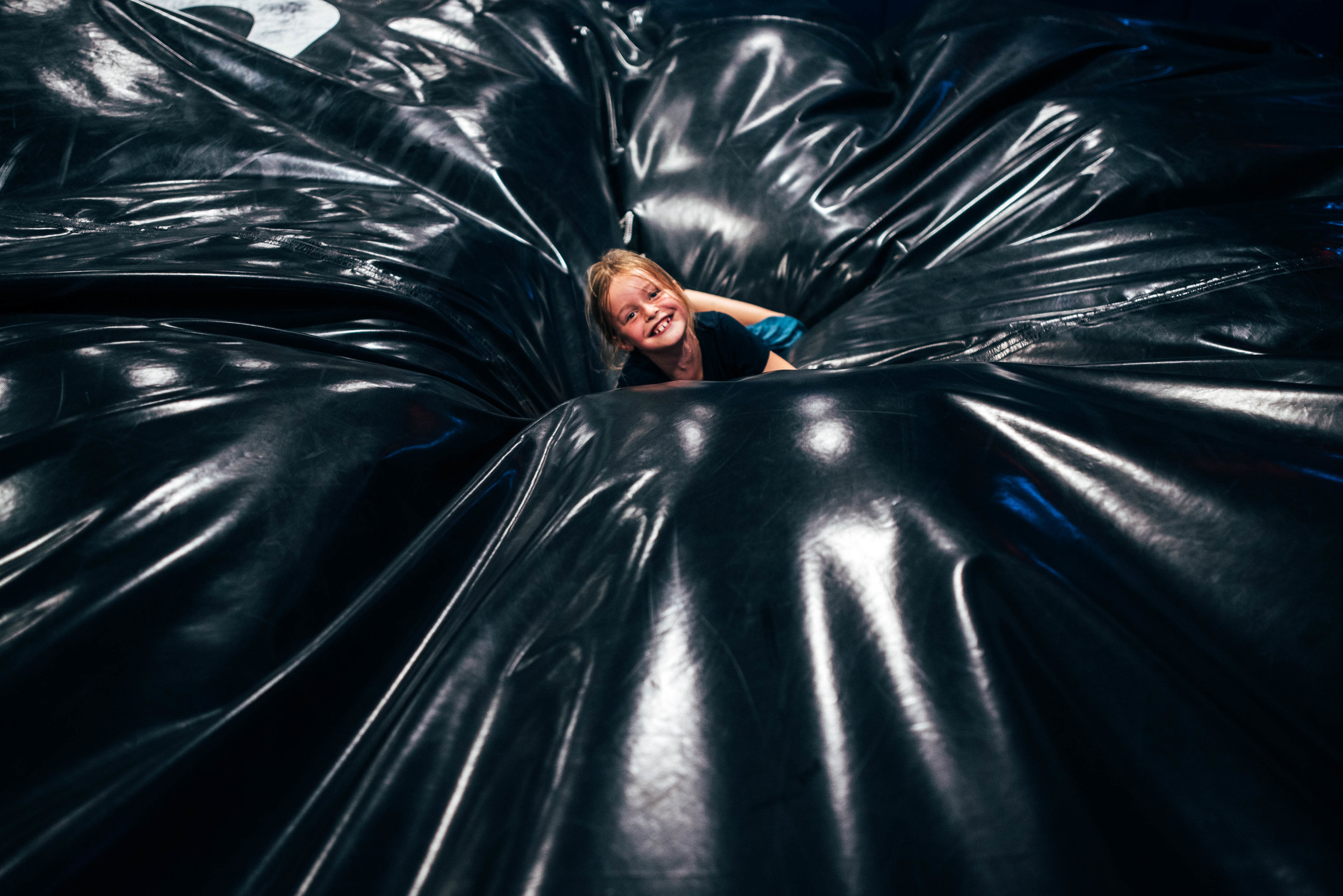 Laughing girl in crash mat Essex UK Documentary Wedding Photographer