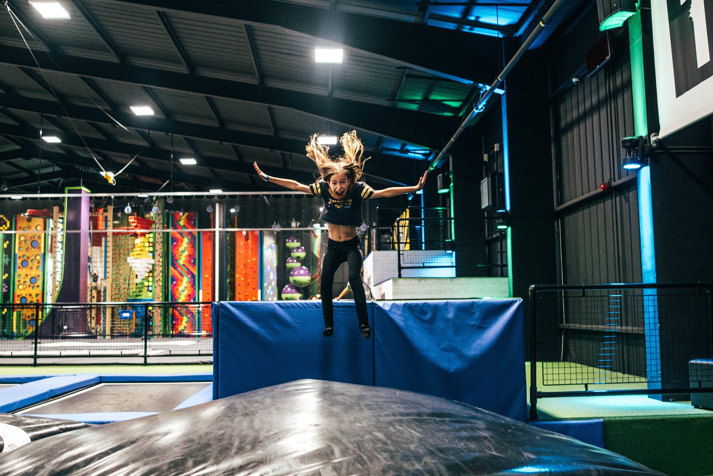 Girls jumps onto crash mat Essex UK Documentary Wedding Photographer