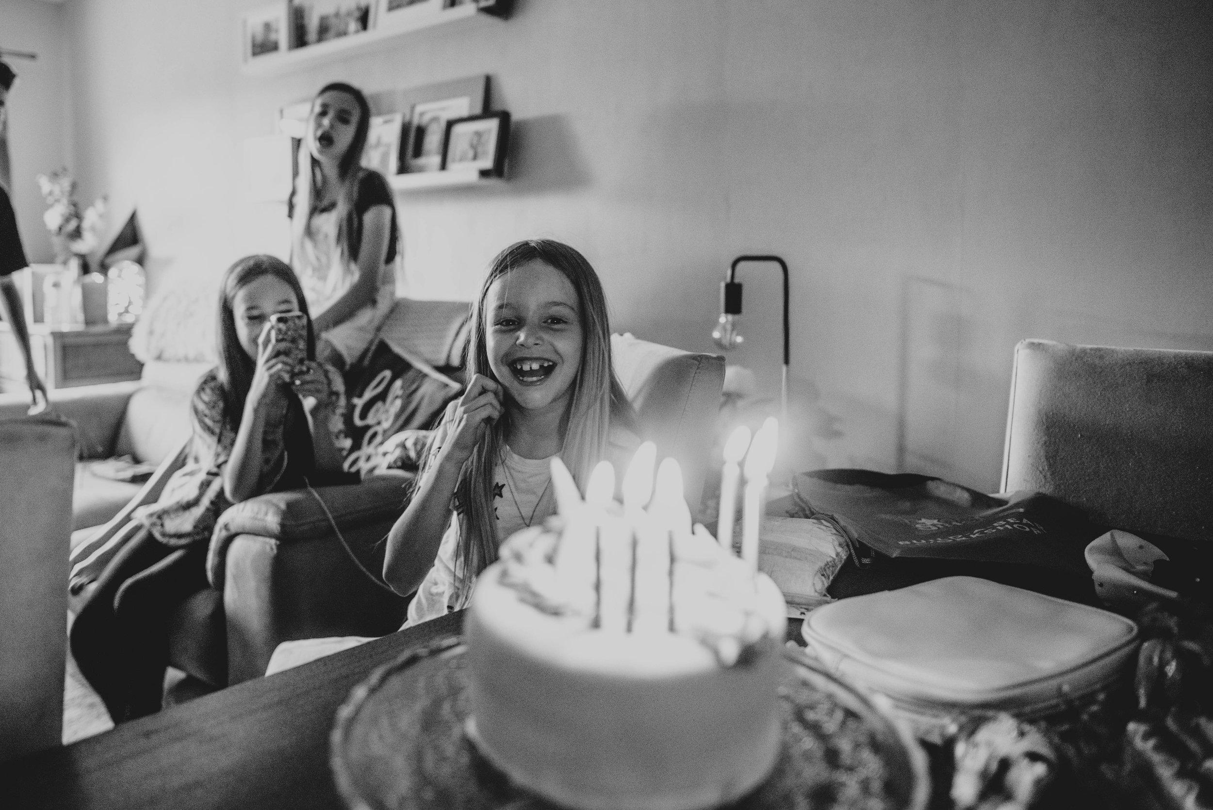 Little girl and birthday cake Essex UK Documentary Wedding Photographer