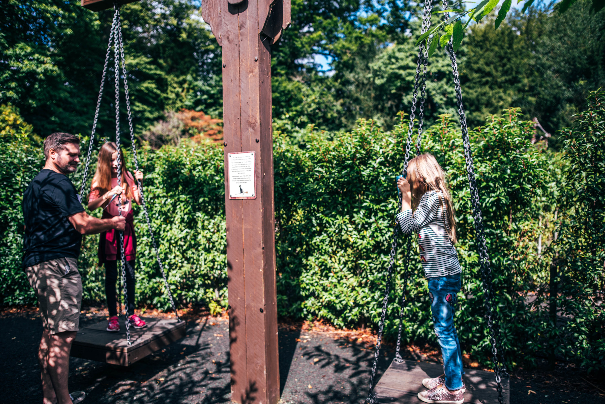 Two girls on Witch Scales at Warwick Castle Essex UK Documentary Wedding Photographer