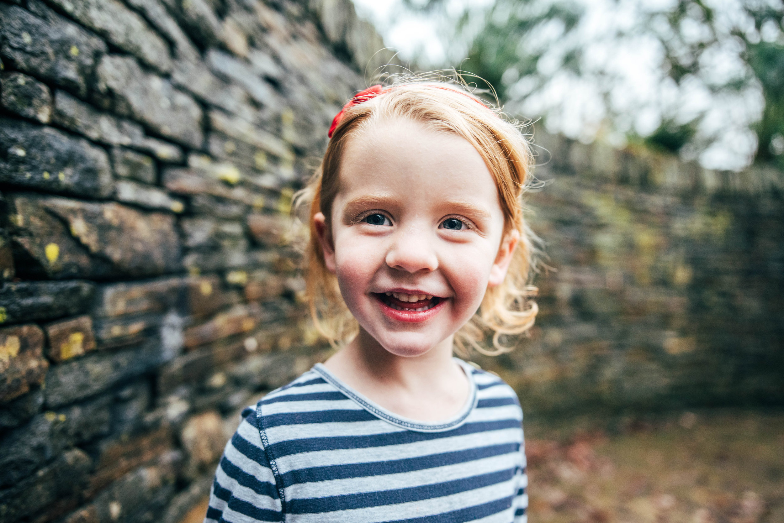 Little Girl by wall Hylands House Essex Documentary Portrait Photographer