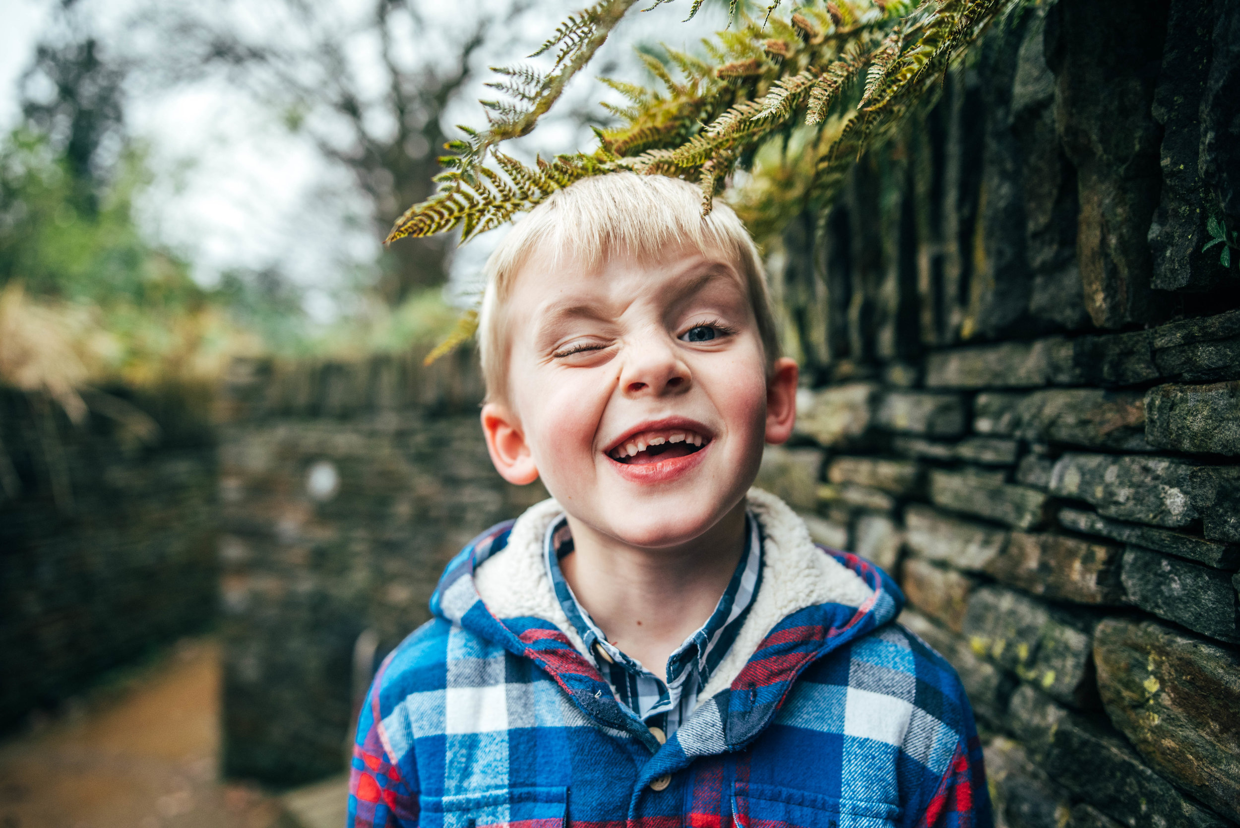 Little boy winks Hylands House Essex Documentary Portrait Photographer