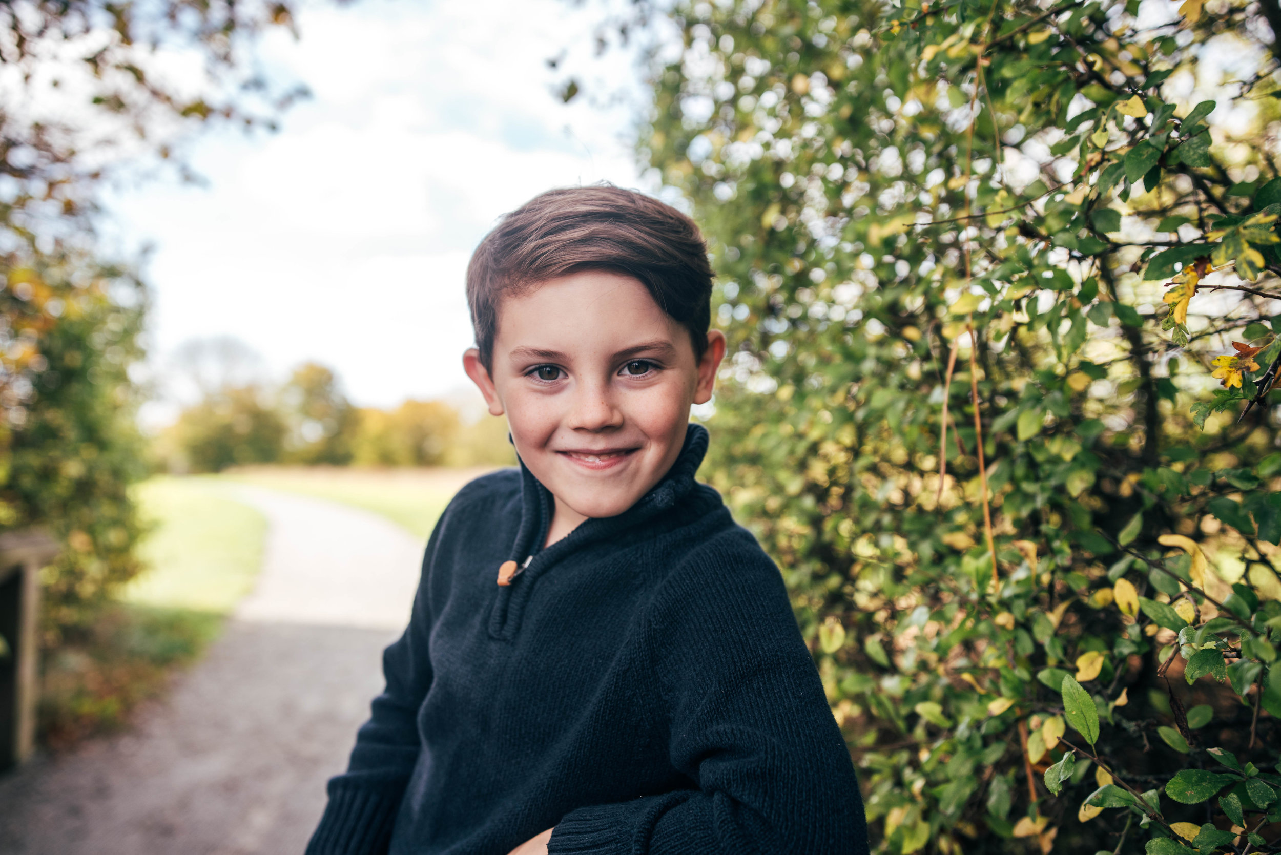Little boy leans on handrail Essex Documentary Portrait Photographer