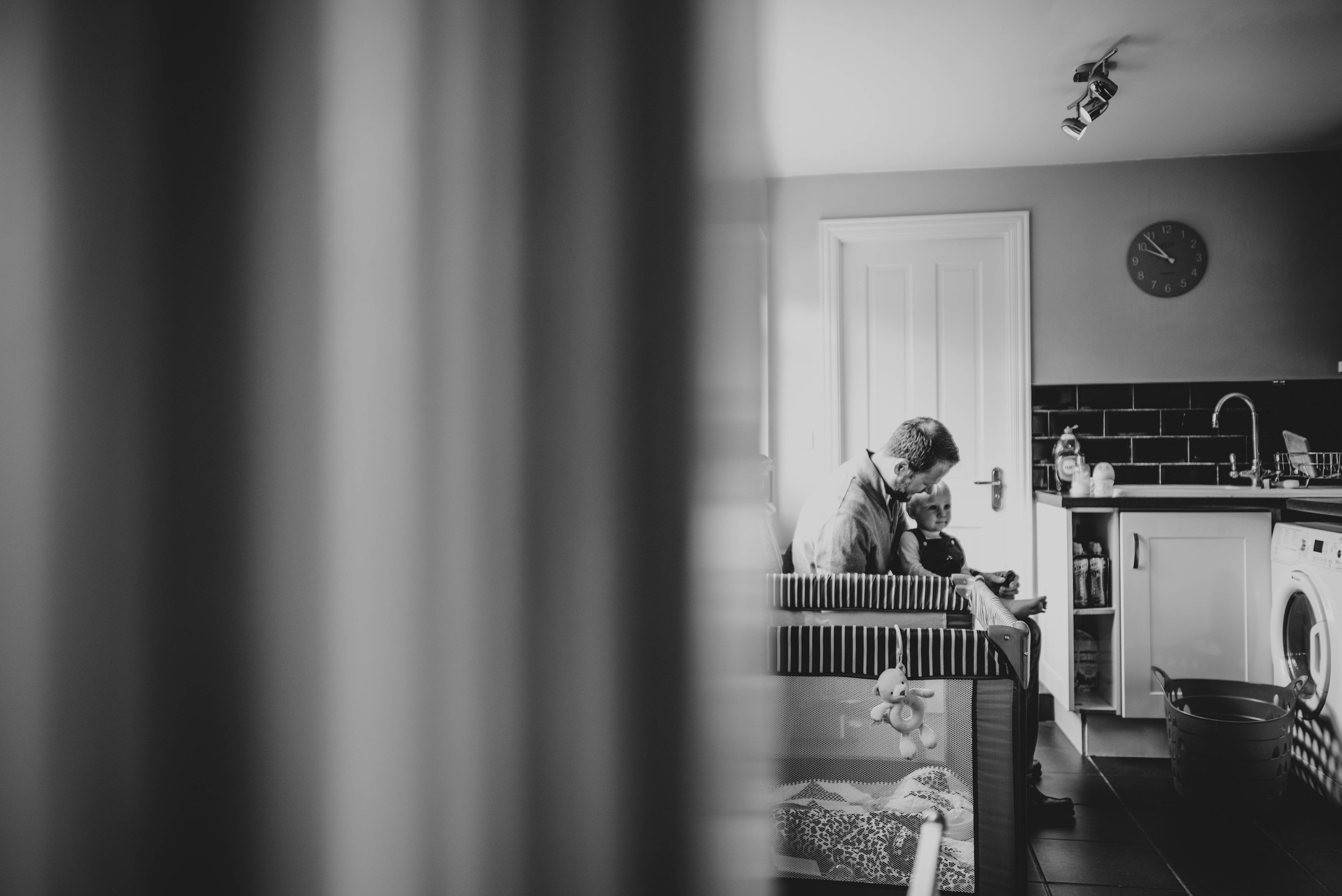 Dad and baby in kitchen Essex Documentary Portrait Photographer